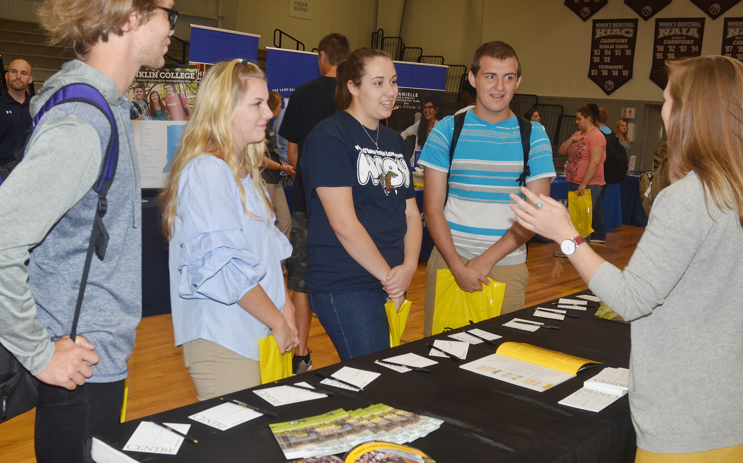 From left, CHS senior Christian Berry, juniors Hayley Stapleton and Elizabeth Sullivan and senior Austin Fitzgerald learn about Centre College.