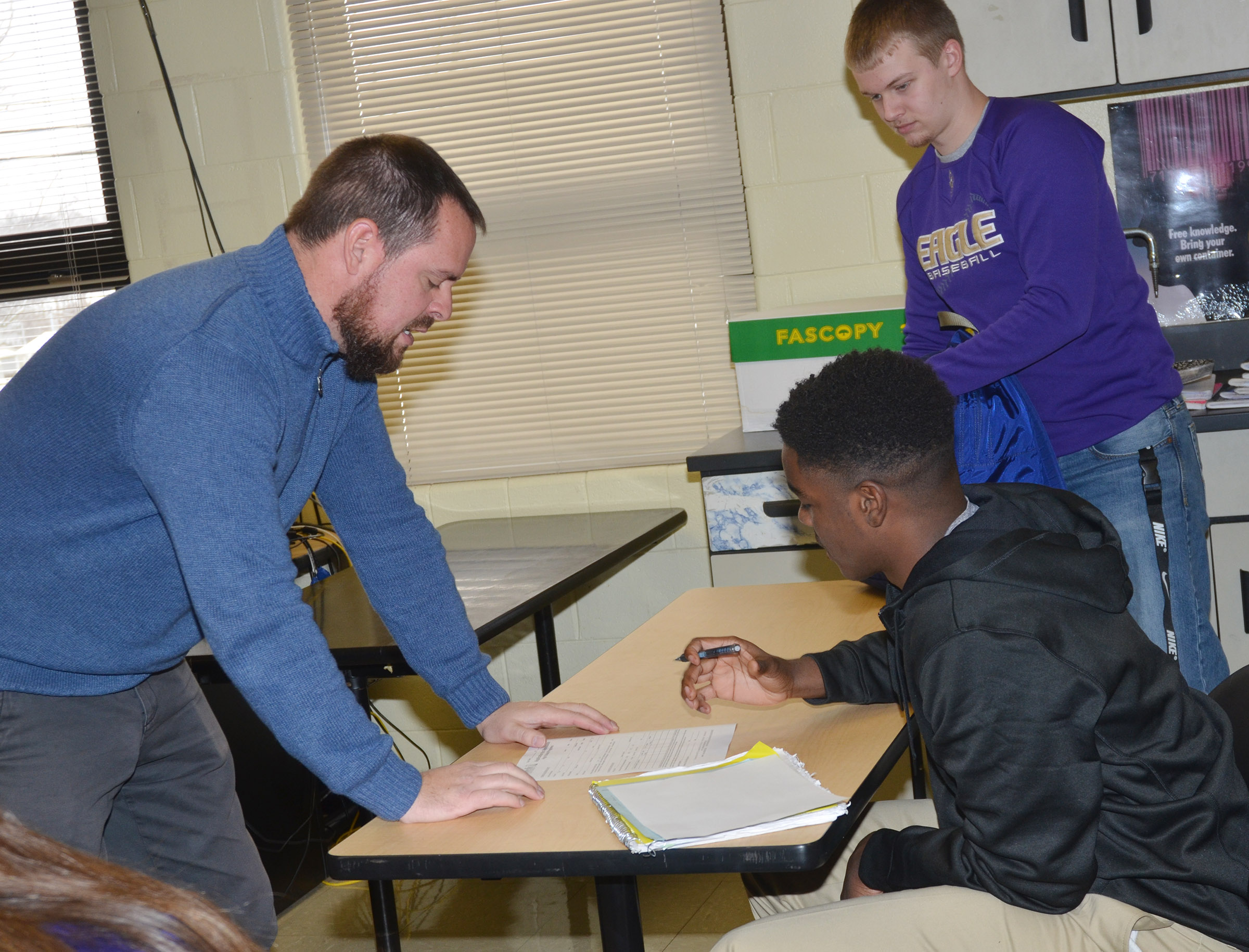 Scott Necessary, director of dual credit at CU, talks to CHS junior Chanson Atkinson about his dual credit application.