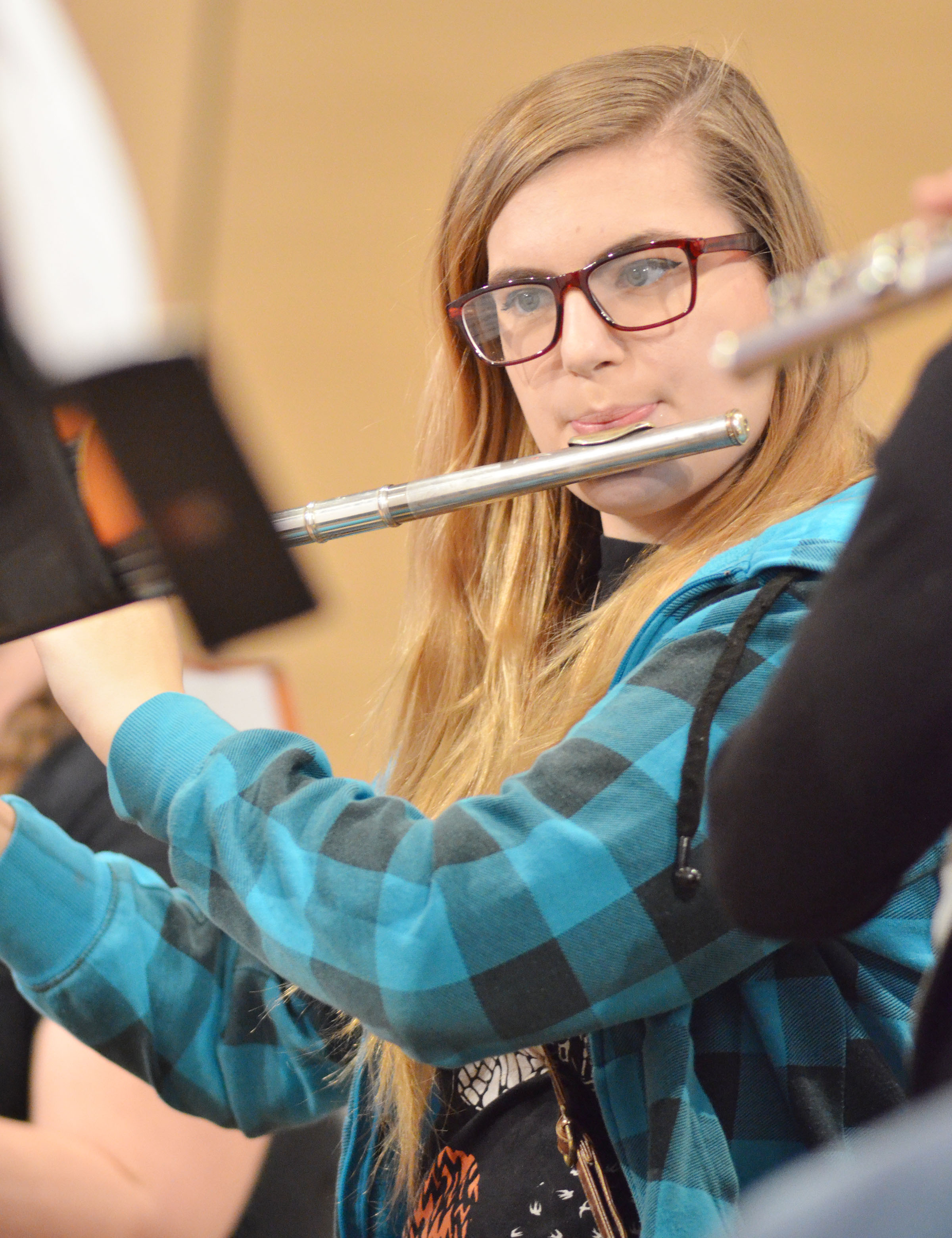 CHS junior Tiffany Kane plays flute during a CU Honors Band rehearsal.