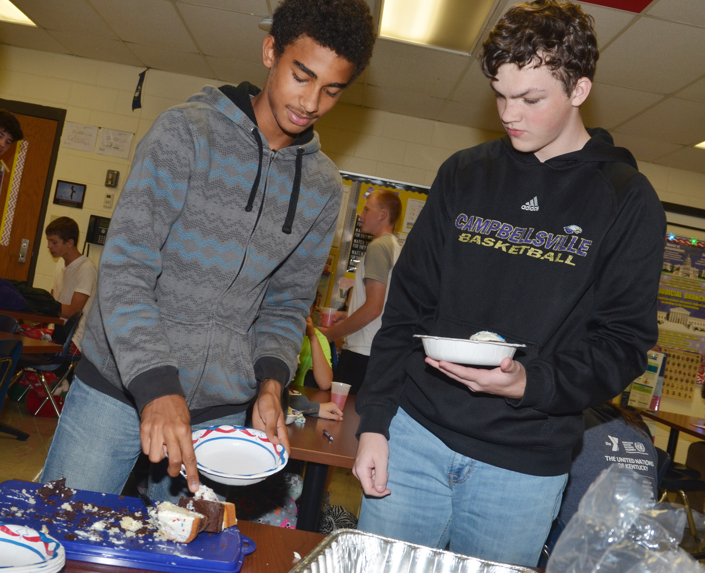 CHS sophomores David Silva, at left, and Jimmy Russell enjoy marble cake cupcakes and layer cake during their Constitution Day party.