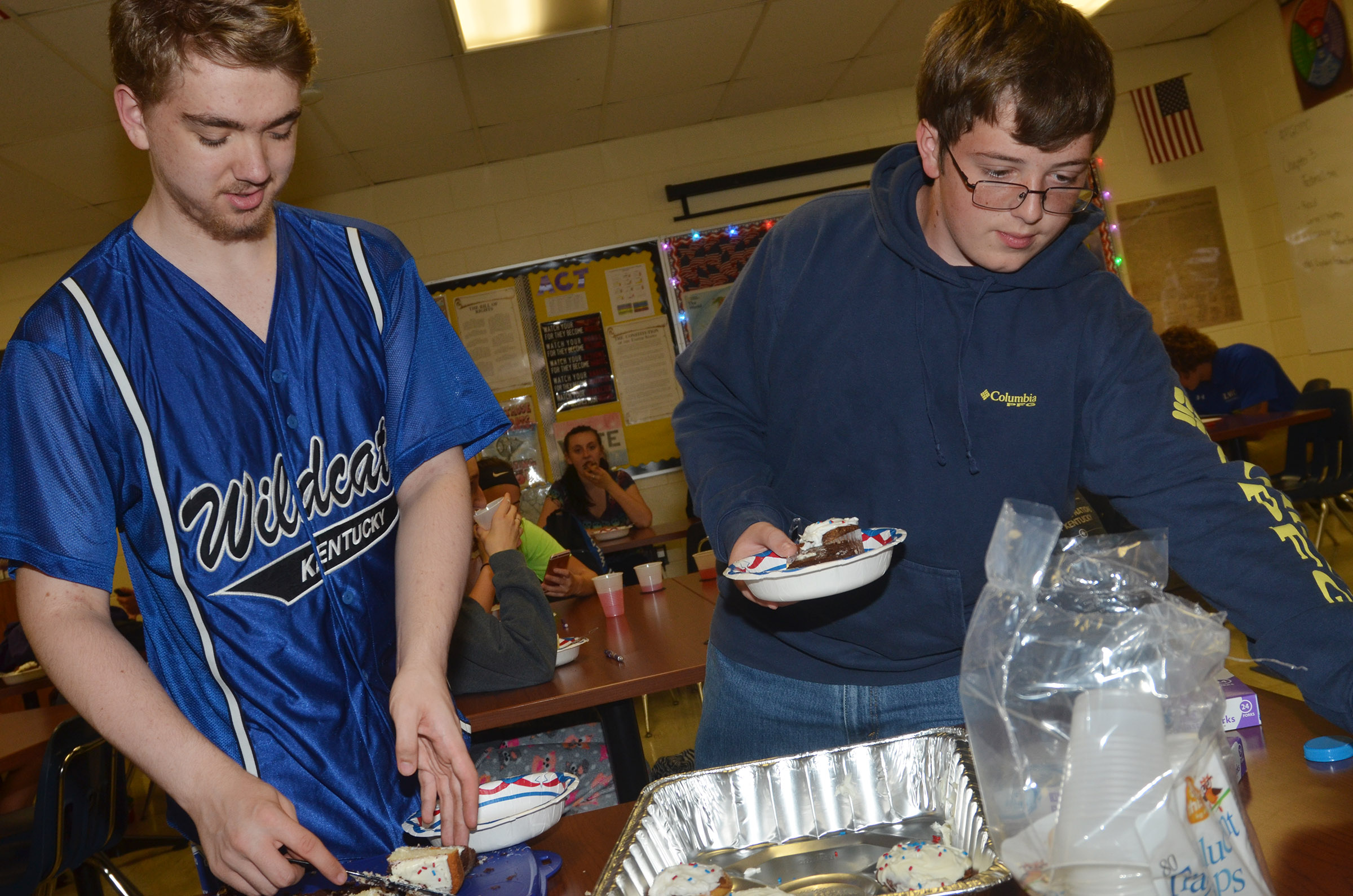 CHS sophomores Anthony Shipione, at left, and Gavin Ford enjoy marble cake cupcakes and layer cake during their Constitution Day party.