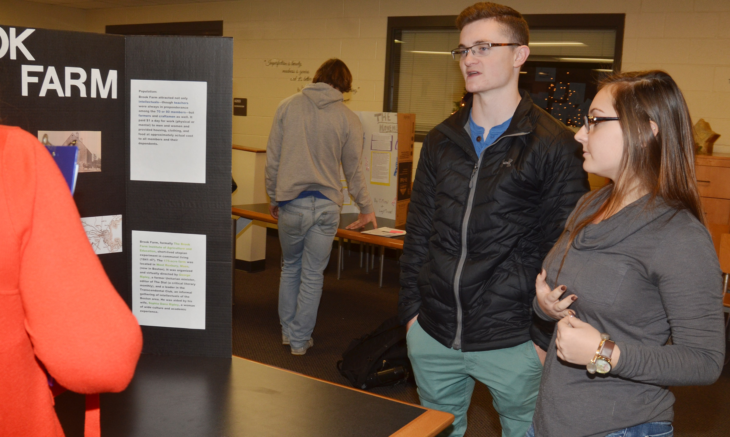 CHS senior Bryce Richardson, at left, and junior Reagan Knight present about the Brook Farm reform movement.