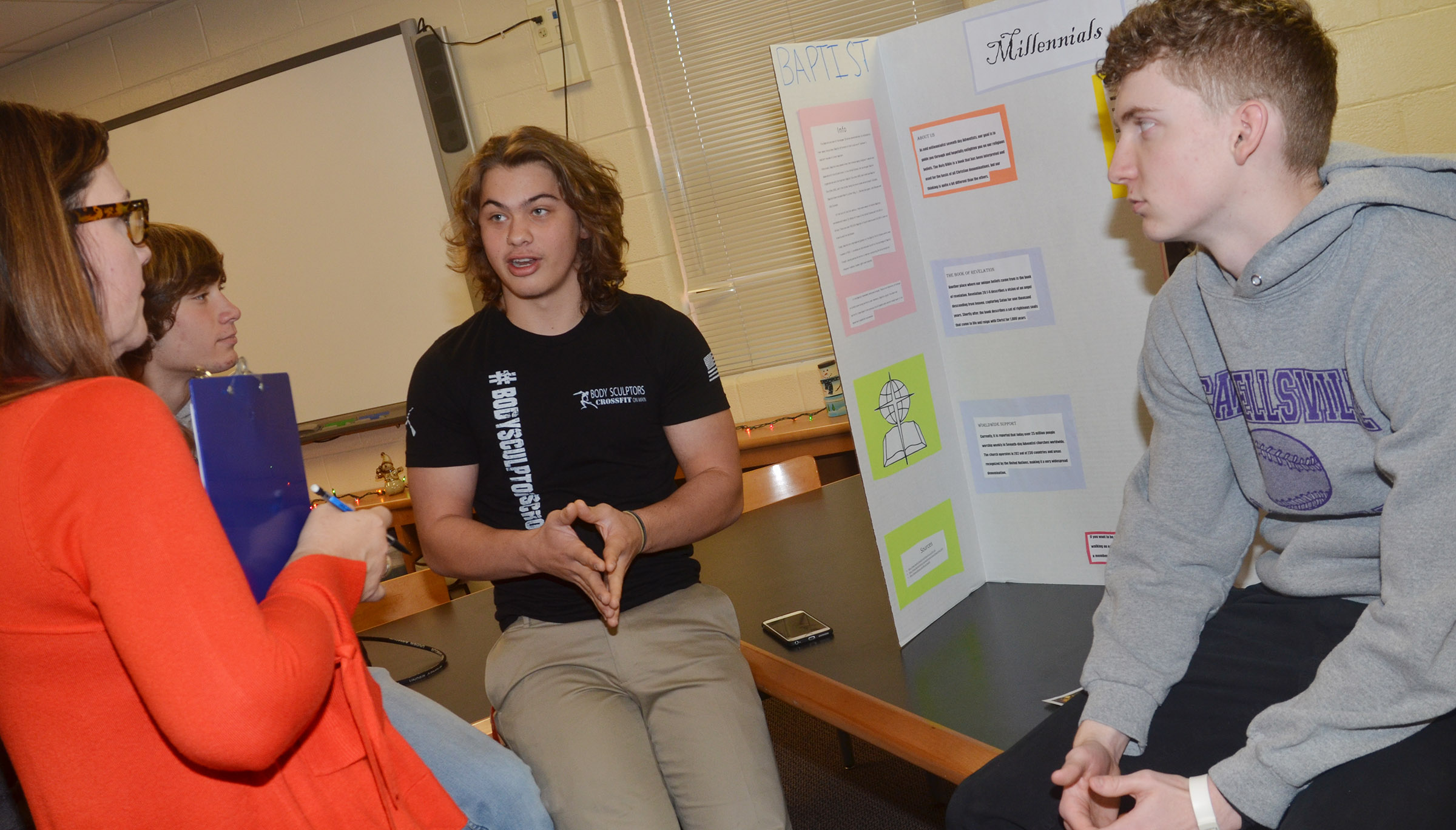 CHS juniors Treyce Mattingly, at left, and Jackson Hinton present about the millennials reform movements.