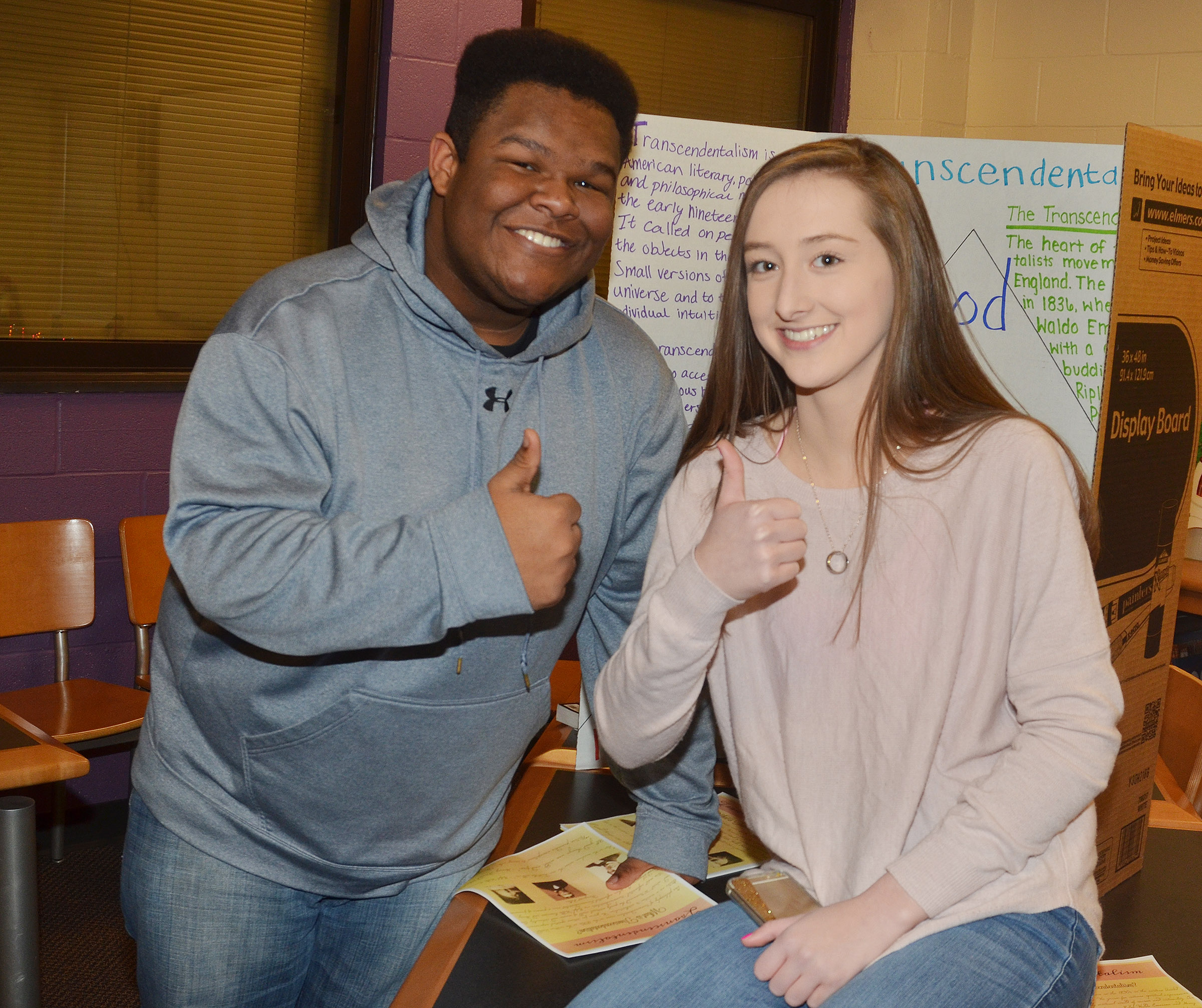 CHS juniors Jeremiah Jackson, at left, and Samantha Mason present about the transcendentalism reform movement.