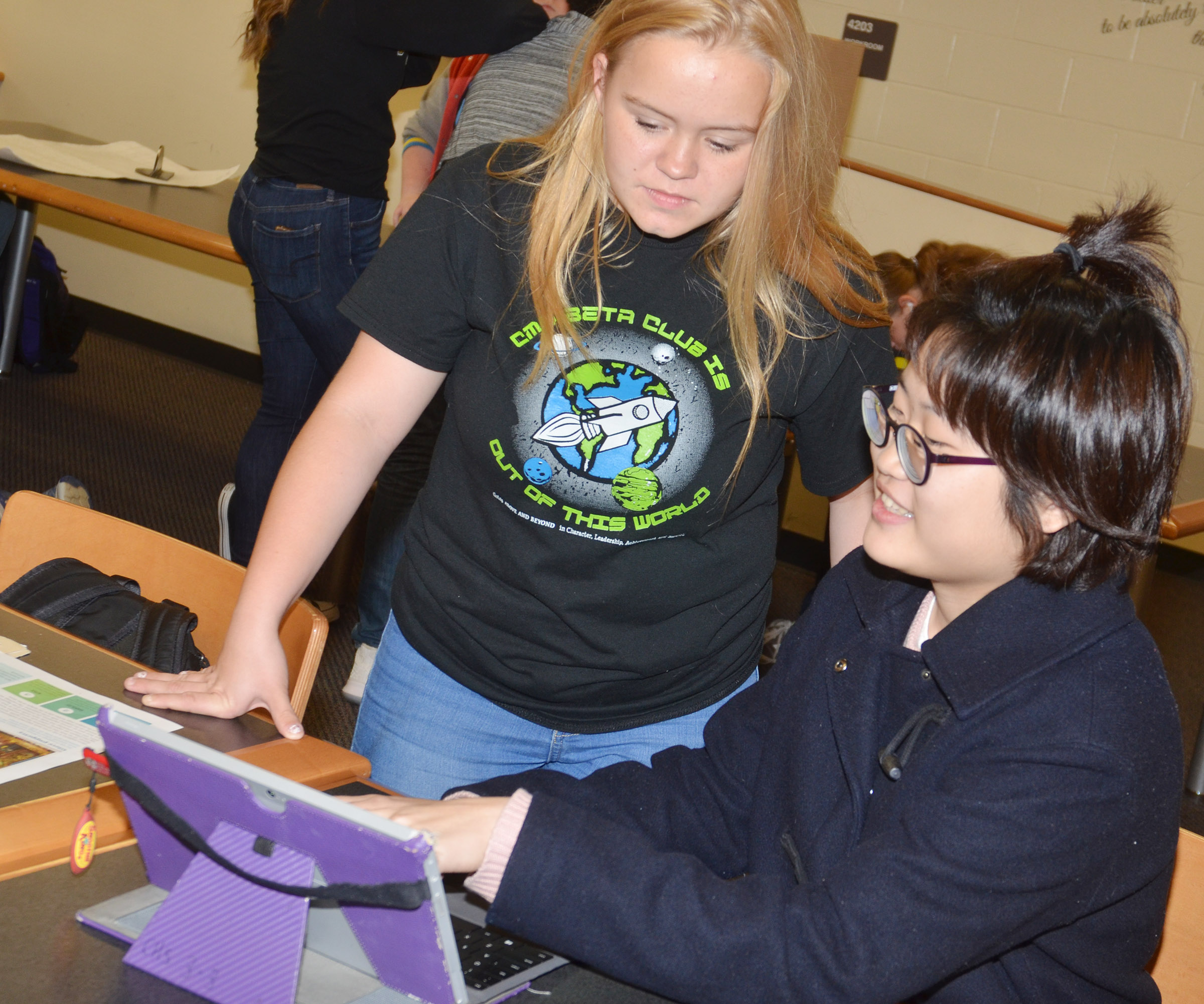 "CHS junior Cherry Kim presents her ""Genius Hour"" project to freshman Riley Rainwater."