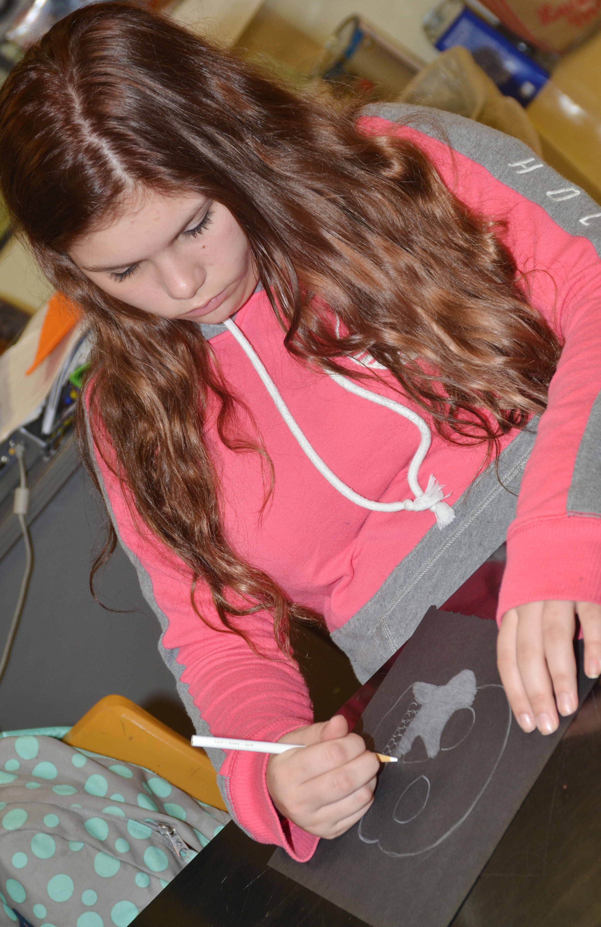 CHS freshman Shelby Hunt colors her Day of the Dead skull.