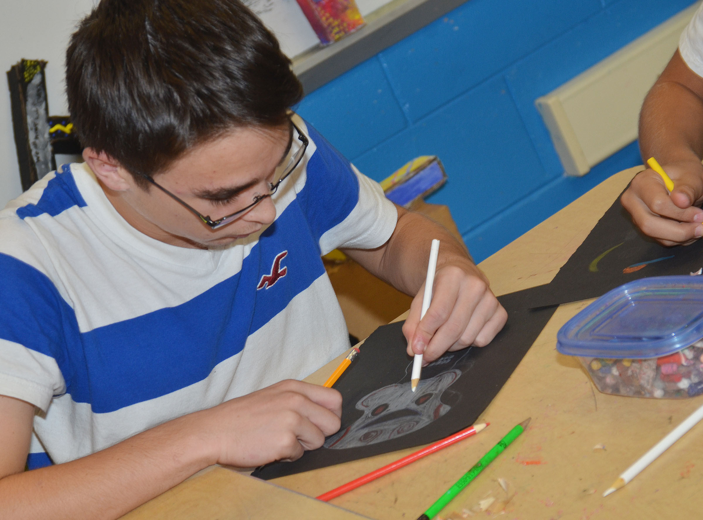 CHS sophomore Skyler Burchett colors his Day of the Dead skull.