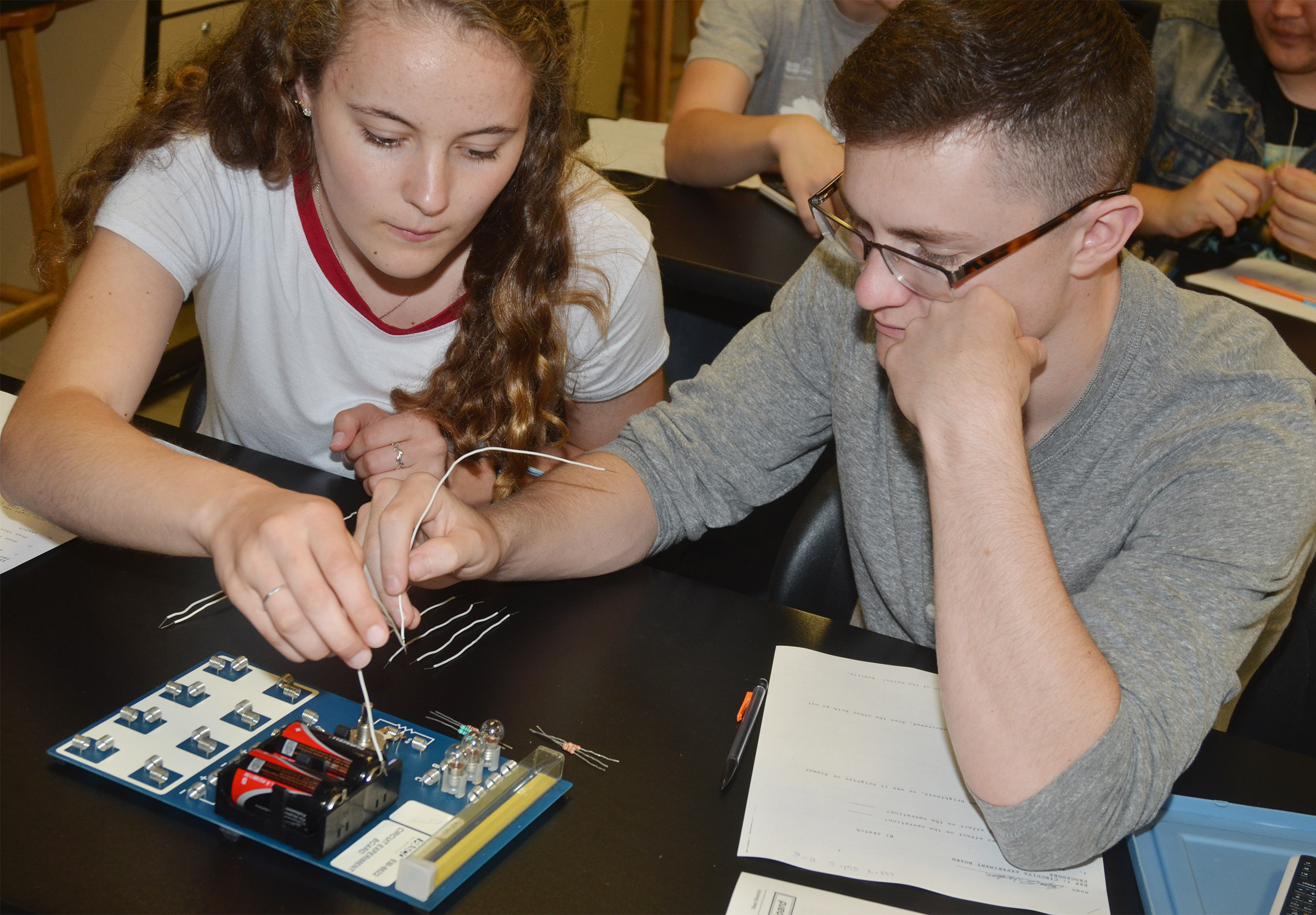 CHS senior Caroline McMahan and junior Bryce Richardson test their batteries.