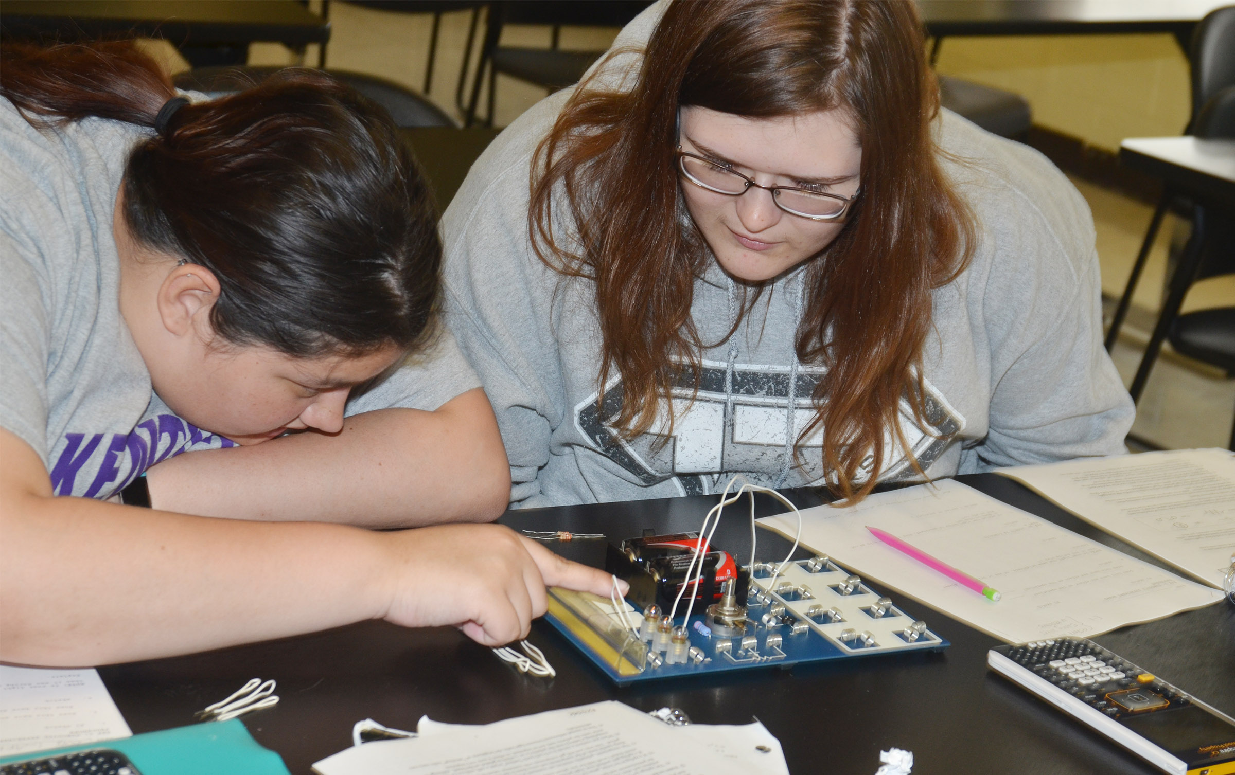 CHS seniors Laura May Gutierrez, at left, and Vera Brown work together to complete a circuit.