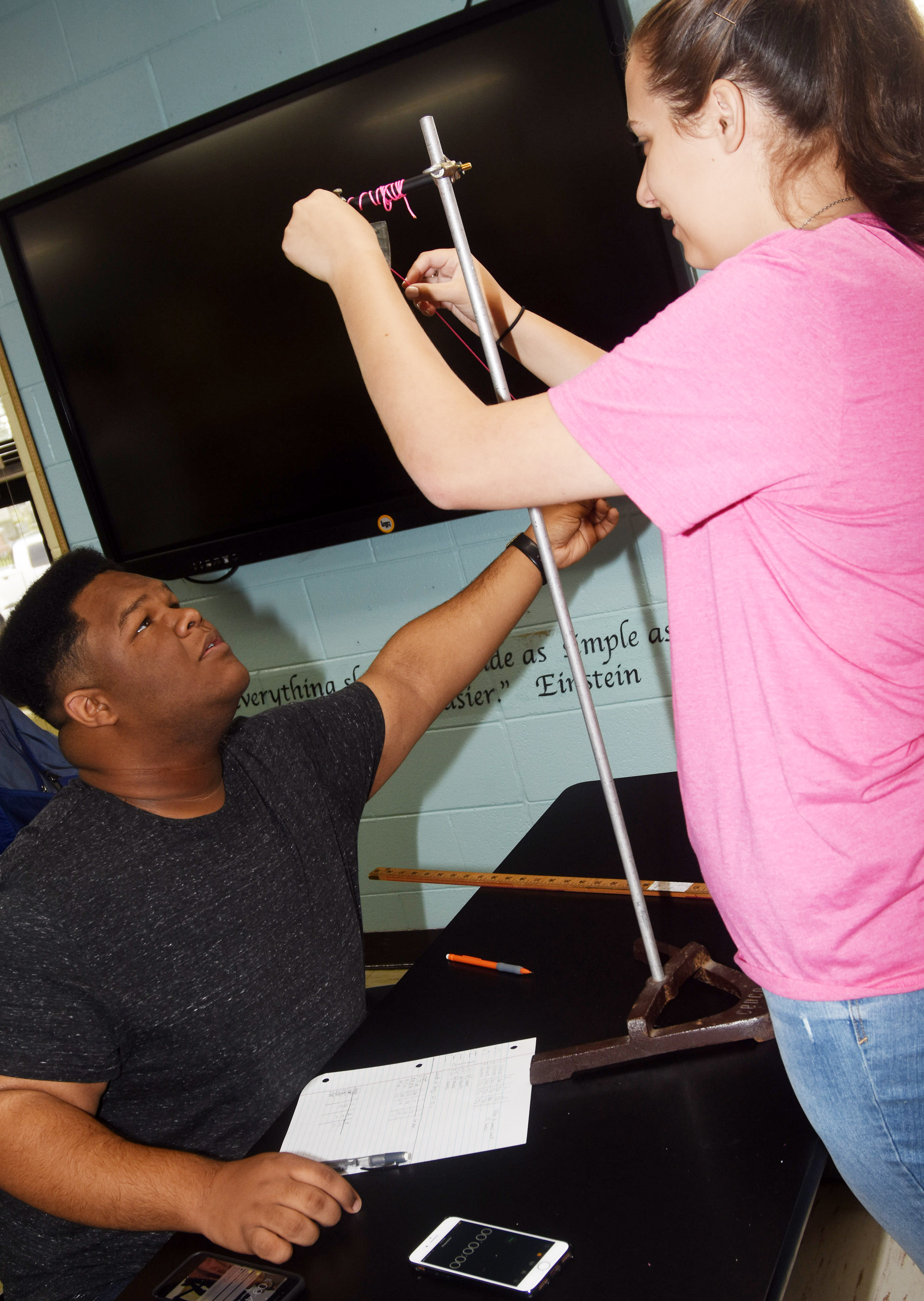 CHS seniors Jeremiah Jackson, at left, and Elizabeth Sullivan vary the weight of their mass as they study gravitational forces.
