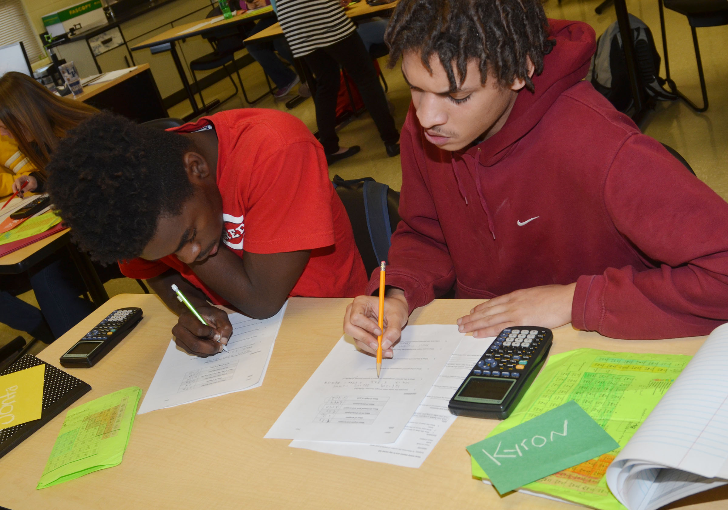 CHS junior Jonta' Strawther, at left, and senior Kyron Statham work together on their lab questions.
