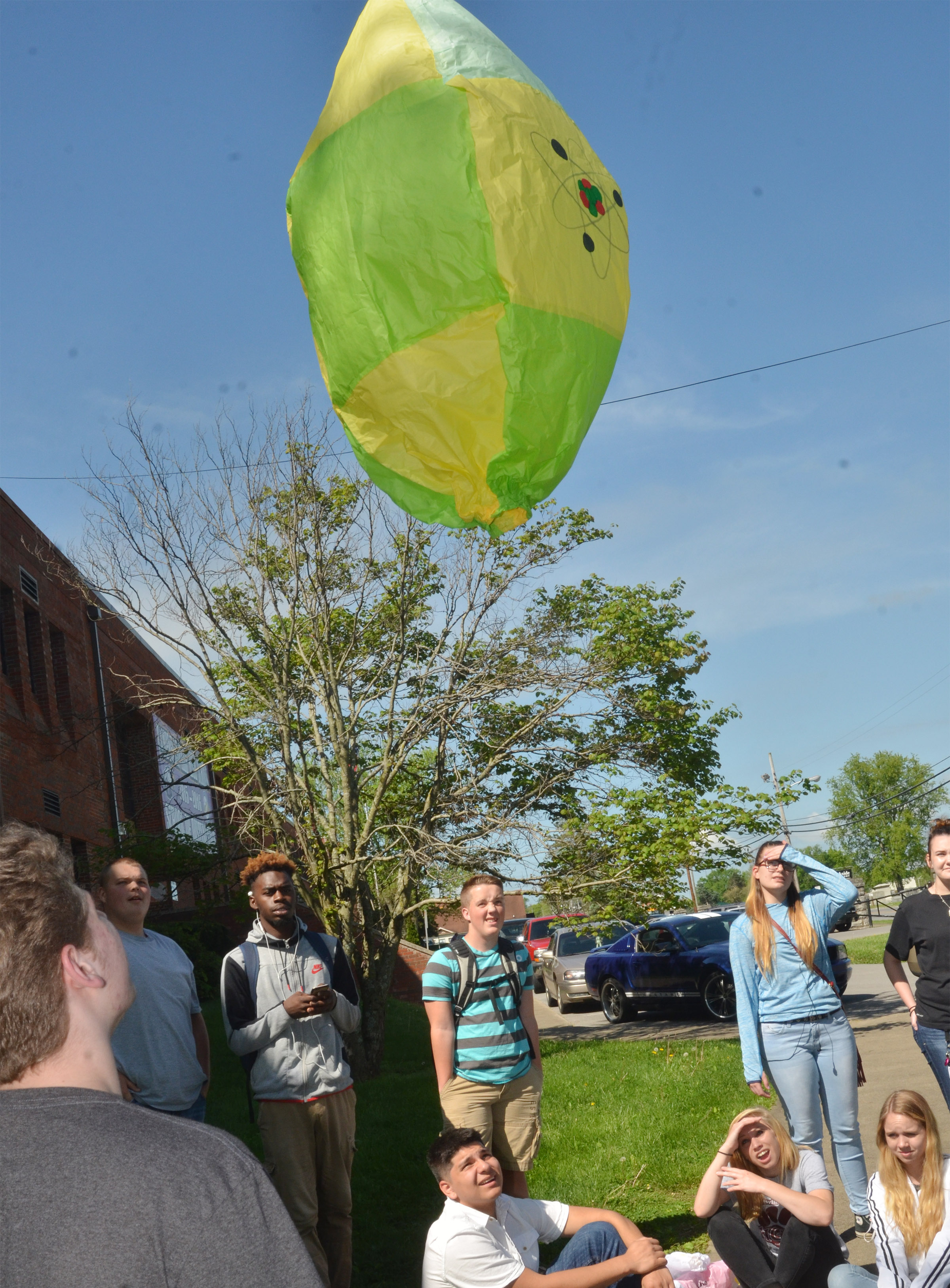 CHS students watch as a hot air balloon flies.