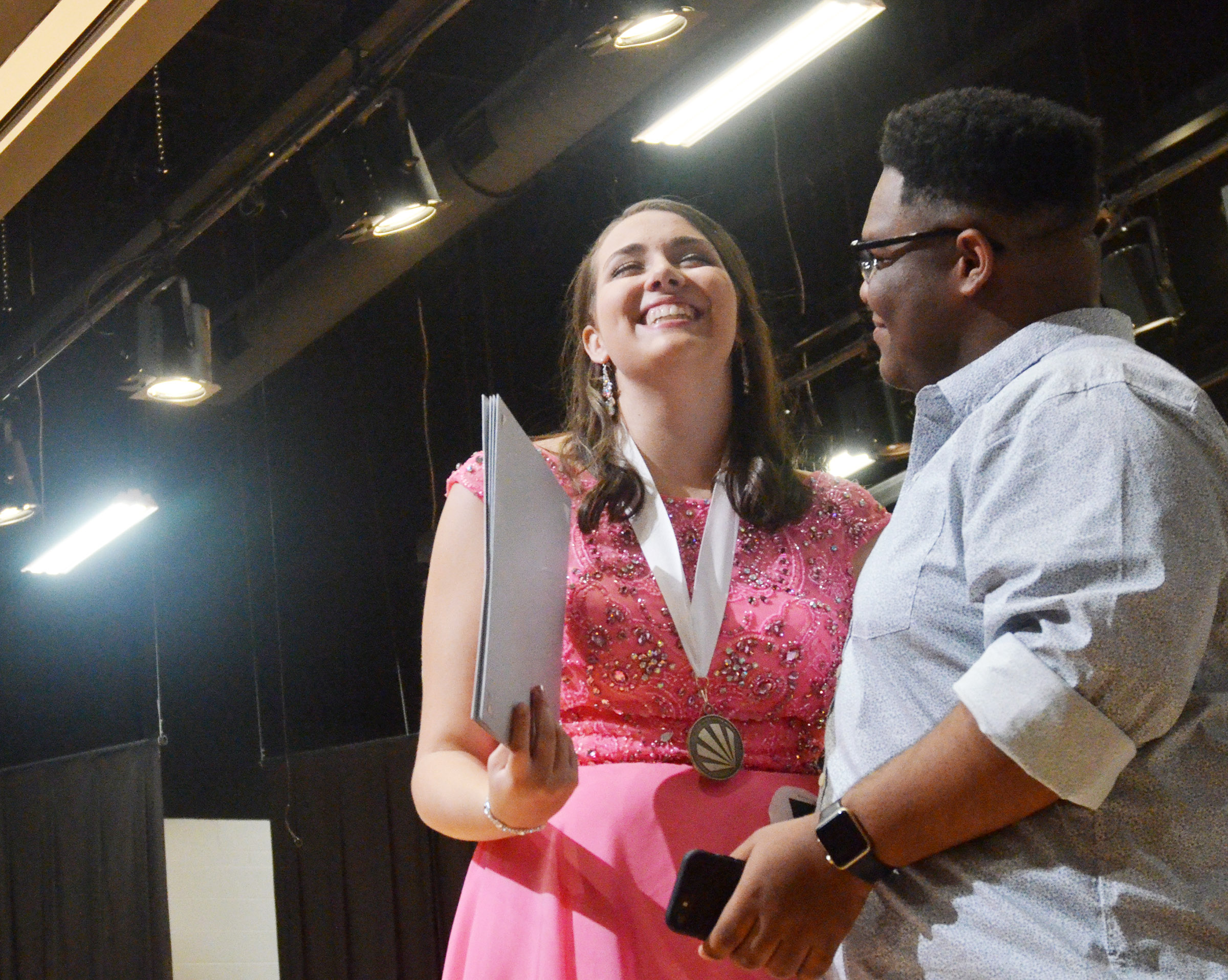CHS senior Elizabeth Sullivan receives congratulations from classmate Jeremiah Jackson after she is named the Taylor County Distinguished Young Woman.