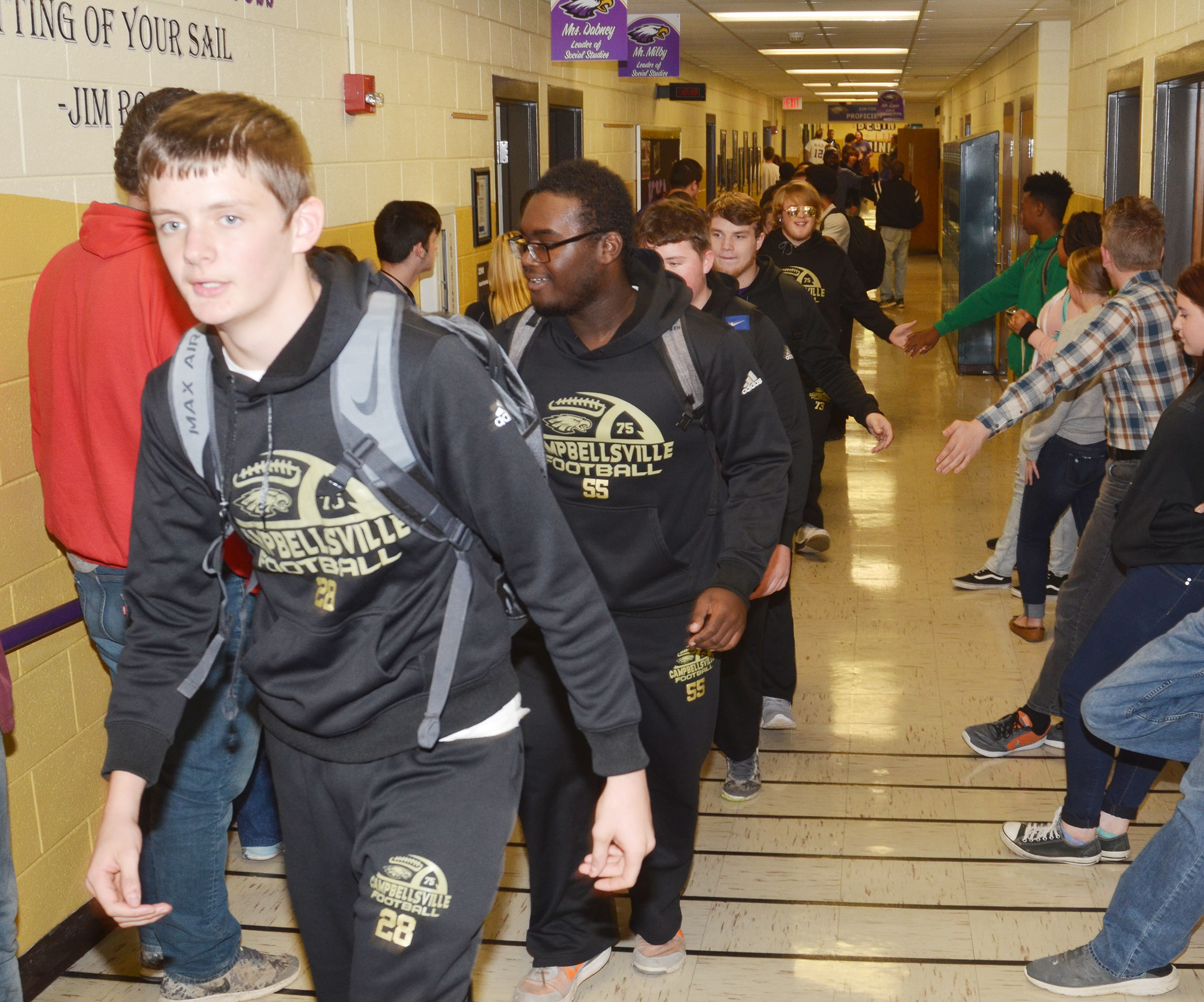 CHS sophomores Blake Allen, at left, and Taekwon McCoy walk with their teammates through the CHS hallways.