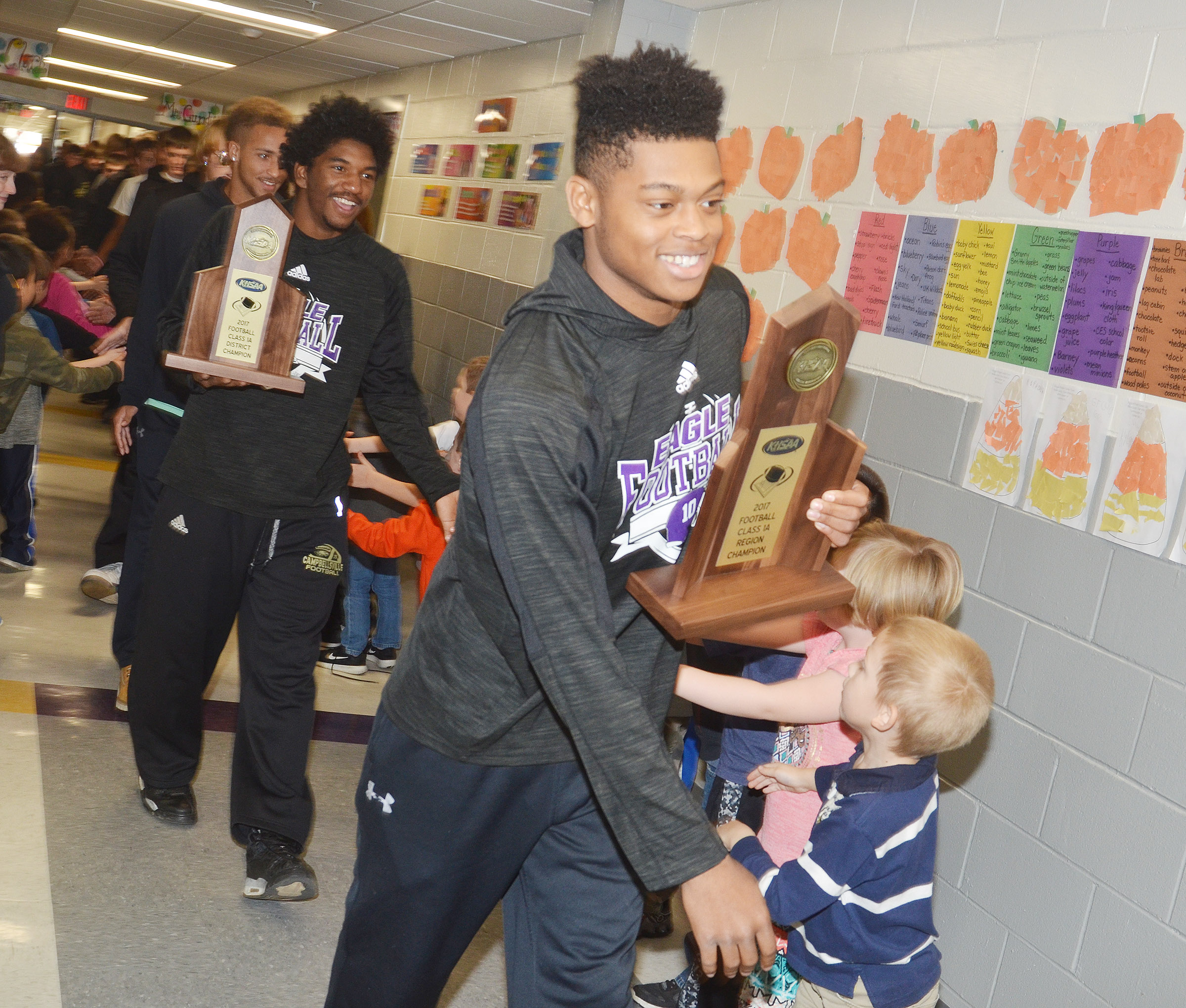 CHS senior Devonte Cubit leads his team in the Eagle Walk through CES. At left is senior Tyrion Taylor.