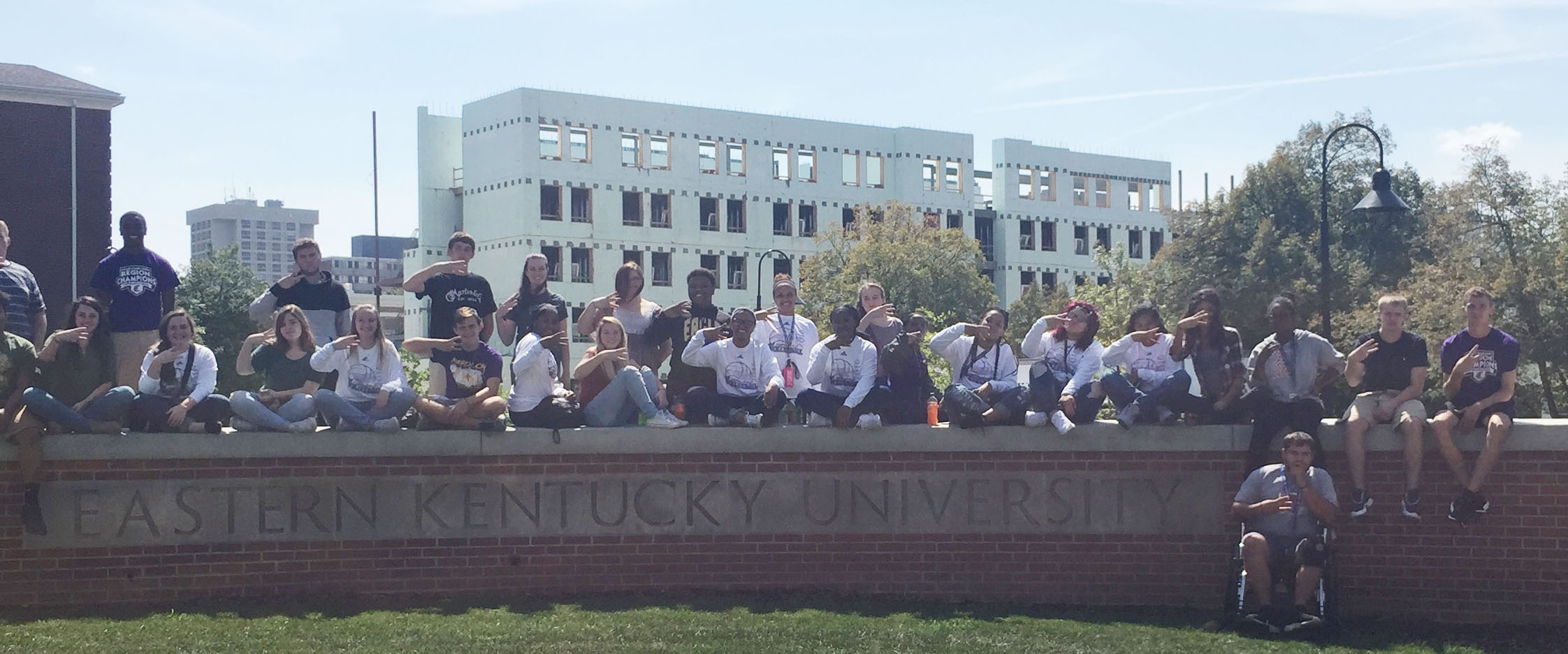 CHS students pose for a photo at the EKU sign on campus.