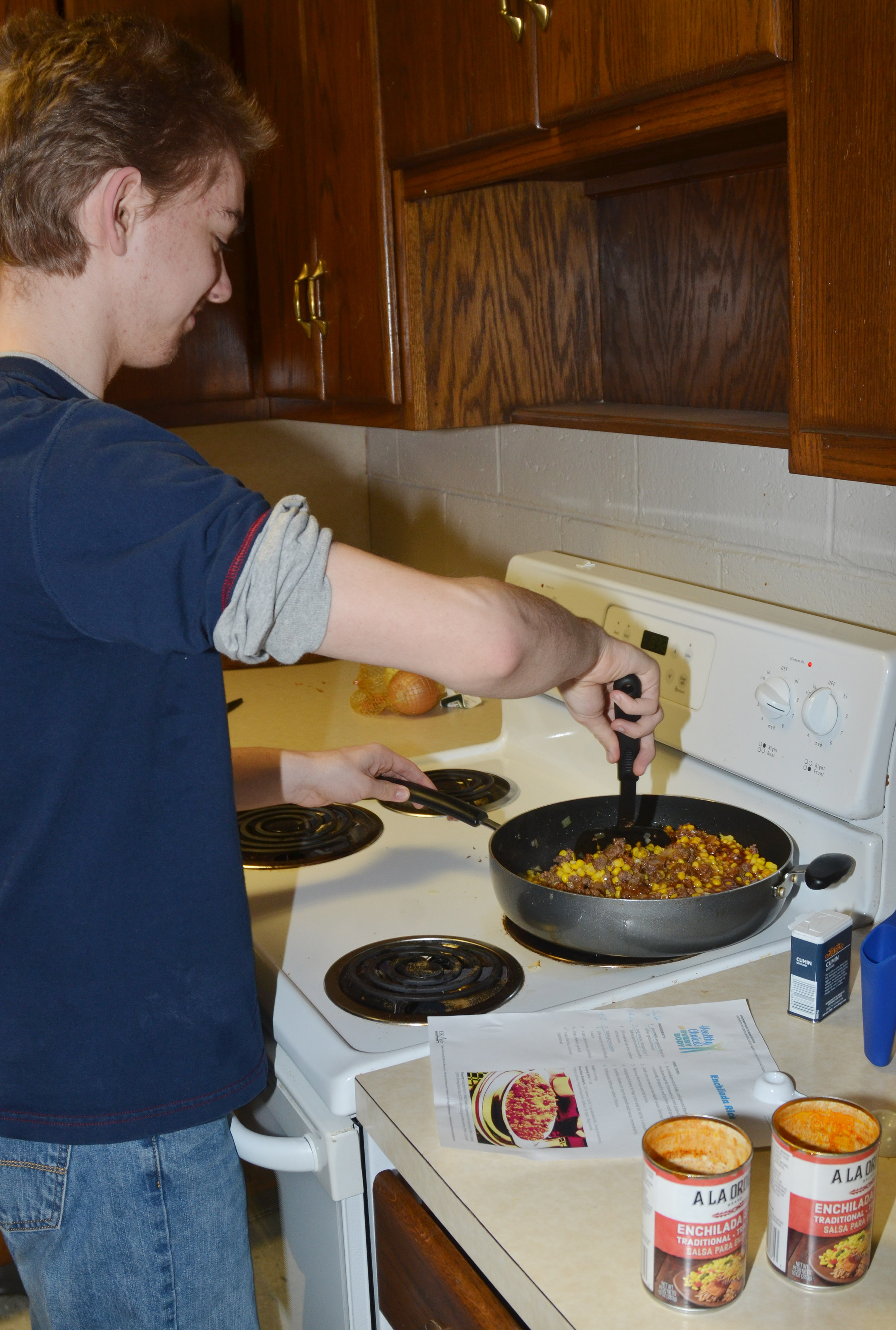 CHS freshman Anthony Shipione stirs the enchilada brown rice.