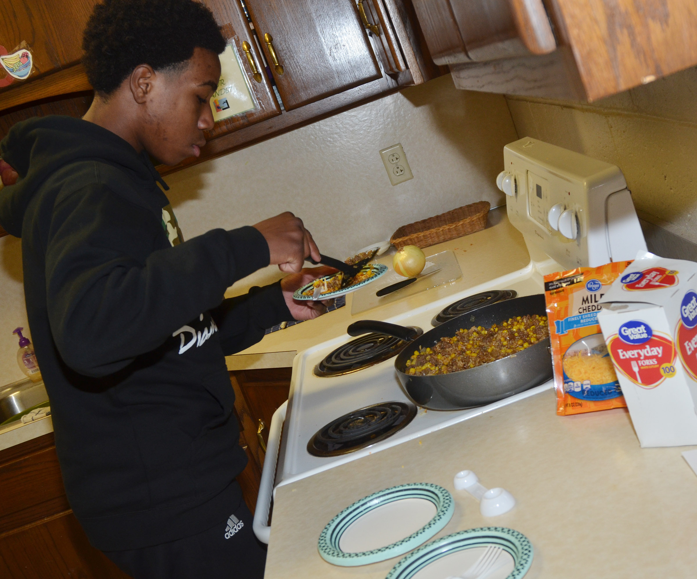 CHS freshman Malachi Corley samples the enchilada brown rice.