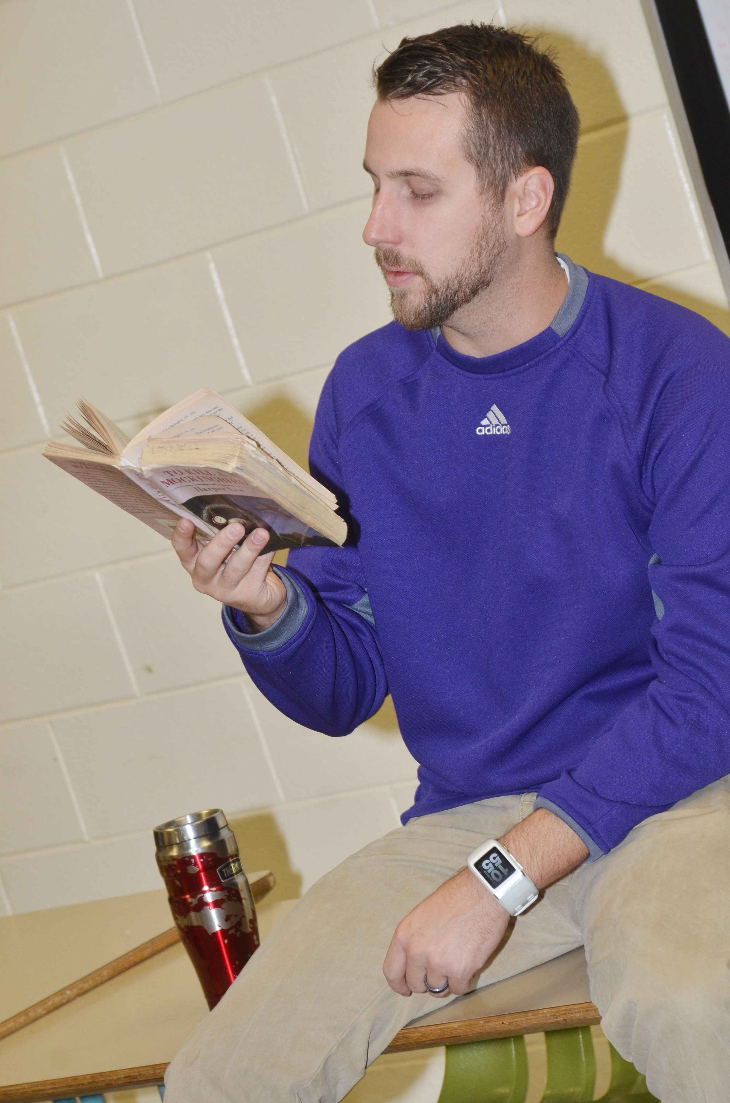 "CHS teacher Tyler Hardy reads ""To Kill A Mockingbird"" to his students."