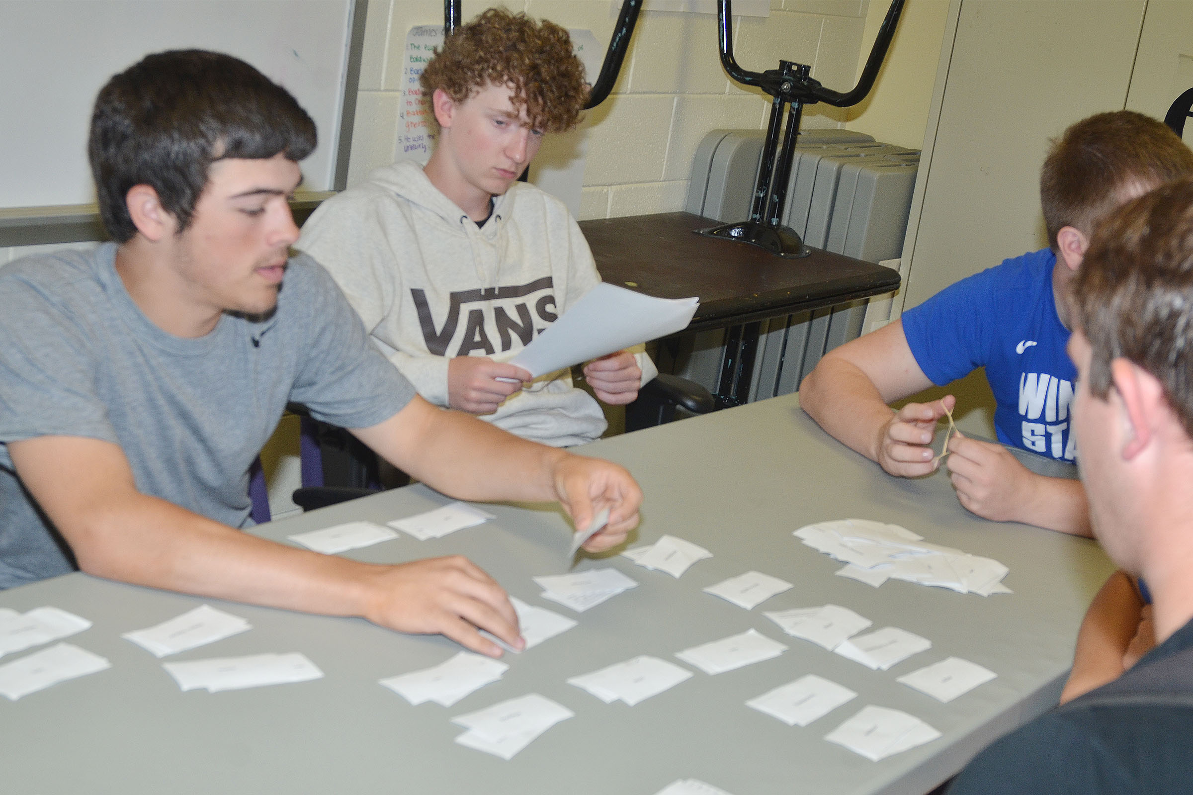 CHS sophomores Ryan Kearney, at left, and Jackson Hinton work with their classmates to pair their poetry terms with the definitions.