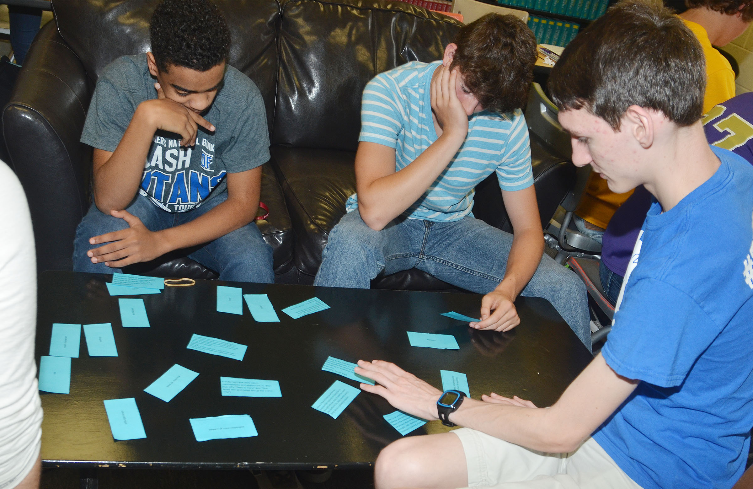 CHS sophomores, from left, Davon Cecil, Mark Rigsby and Ian McAninch work to pair their poetry terms with the definitions.