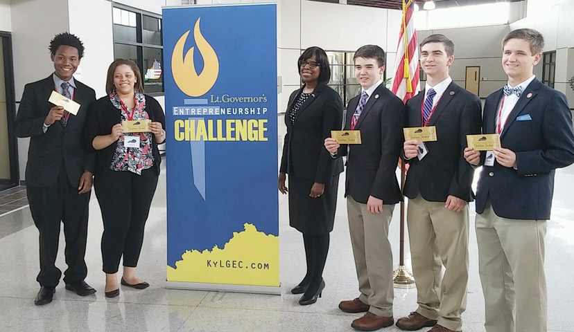 On Tuesday, April 11, CHS freshman Cole Kidwell, sophomore Myles Murrell and junior Cass Kidwell won the Lt. Governor's Entrepreneurship Challenge and now advance to state competition. They are pictured with Kentucky Lt. Gov. Jenean Hampton, third from left. To the right of her, from left, are Cole Kidwell, Cass Kidwell and Myles Murrell.