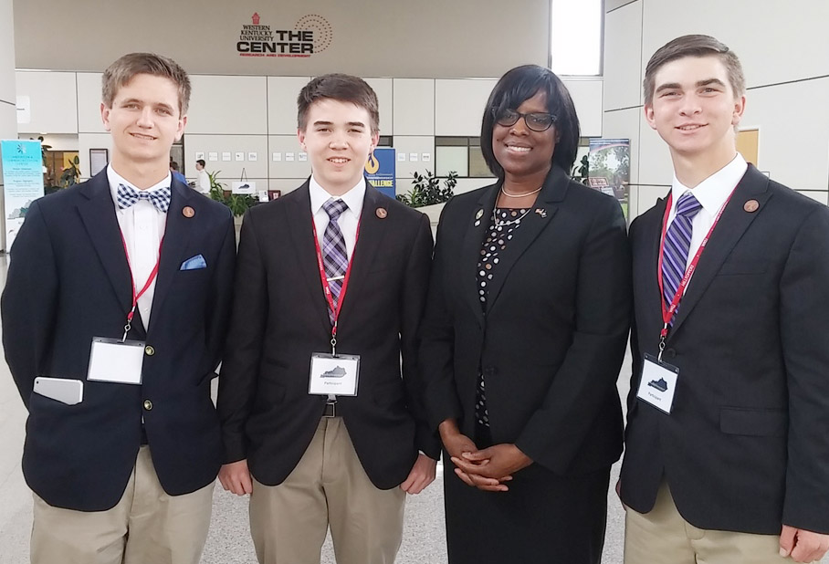 On Tuesday, April 11, CHS freshman Cole Kidwell, sophomore Myles Murrell and junior Cass Kidwell won the Lt. Governor's Entrepreneurship Challenge and now advance to state competition. From left are Murrell, Cole Kidwell, Kentucky Lt. Gov. Jenean Hampton and junior Cass Kidwell.