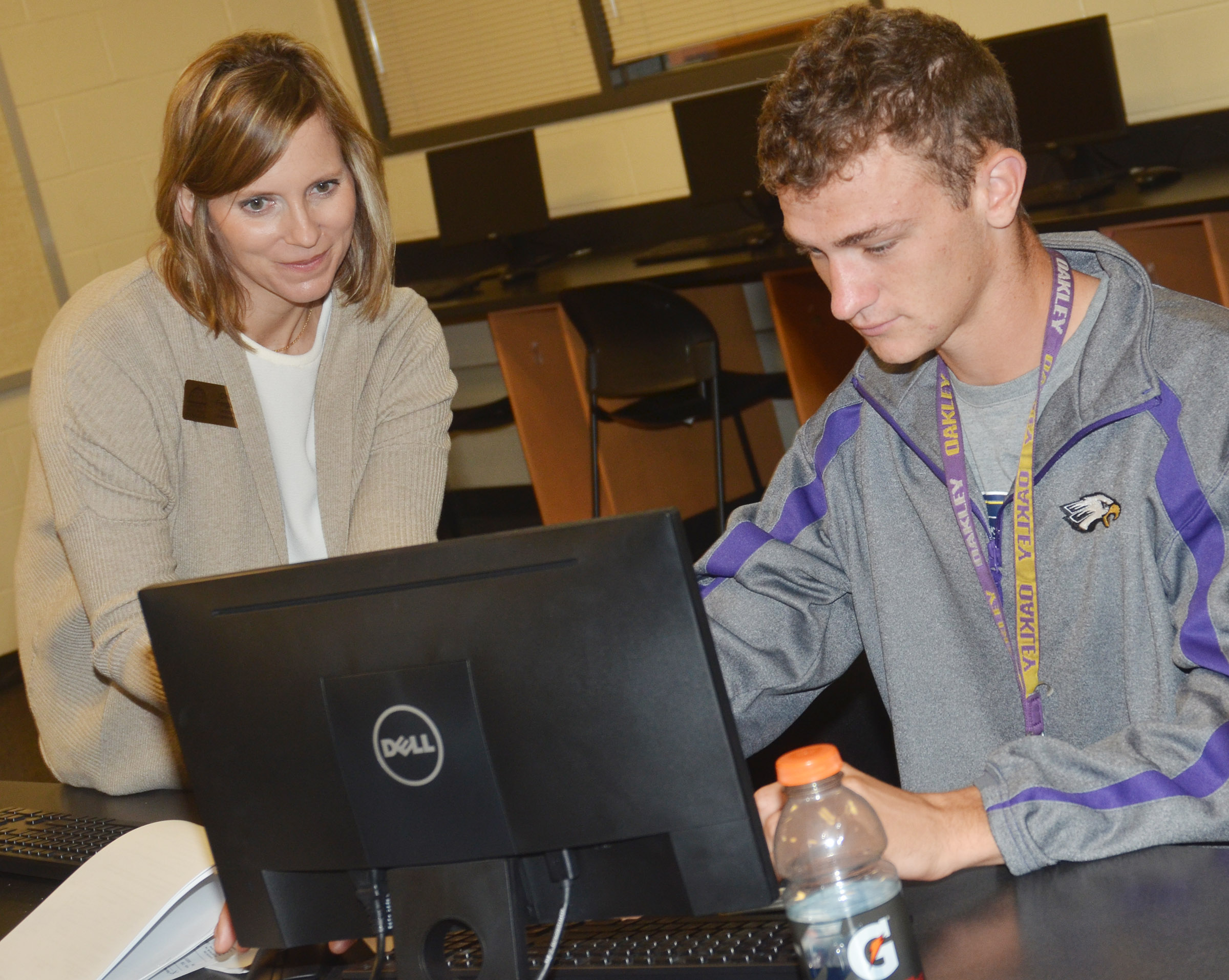 CHS senior Connor Wilson completes his FAFSA, with help from Charity Ferguson, director of admissions at Lindsey Wilson College.