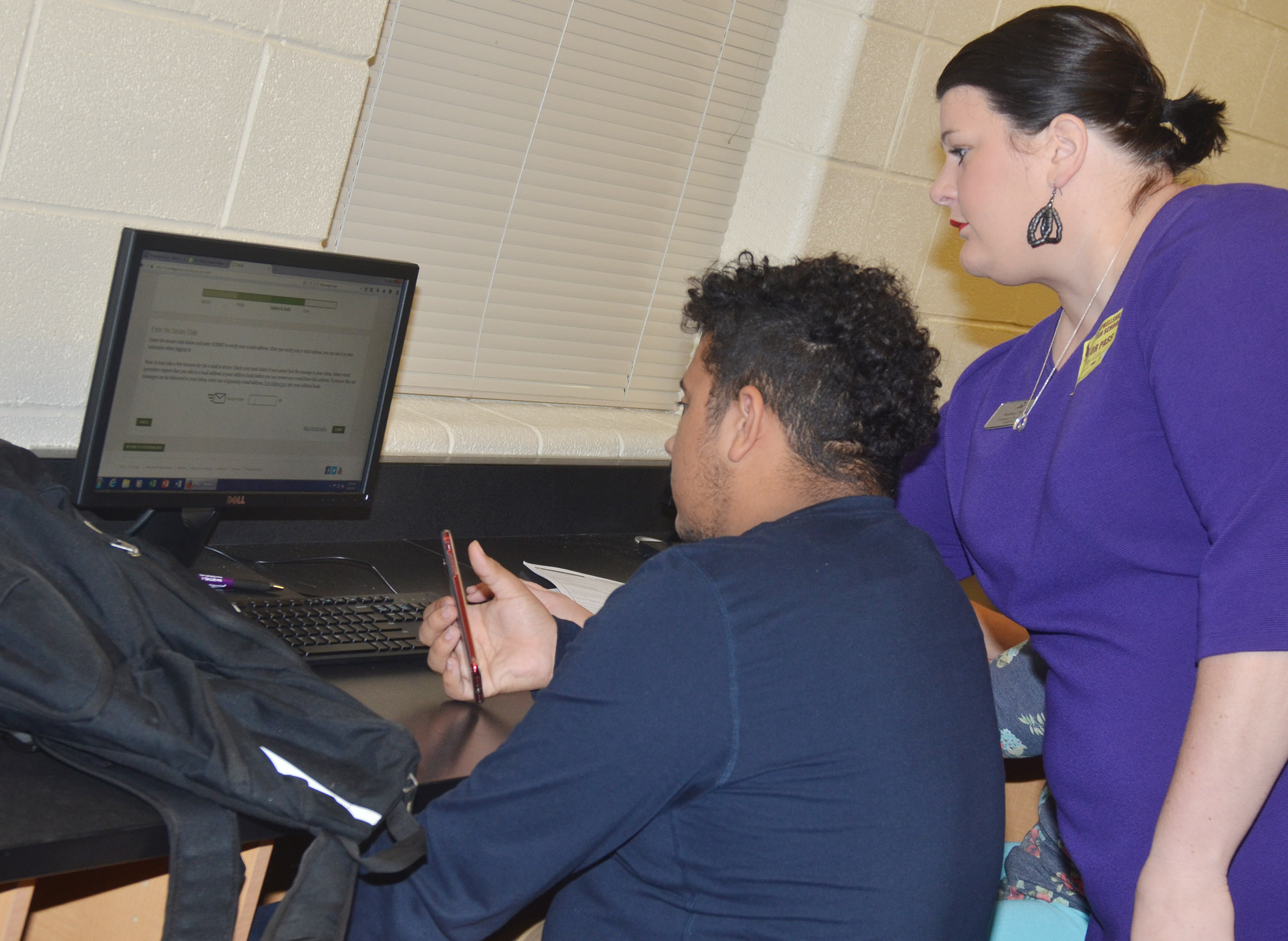 KHEAA representative Audrey Price helps CHS senior Adrian Cravens complete his FAFSA.