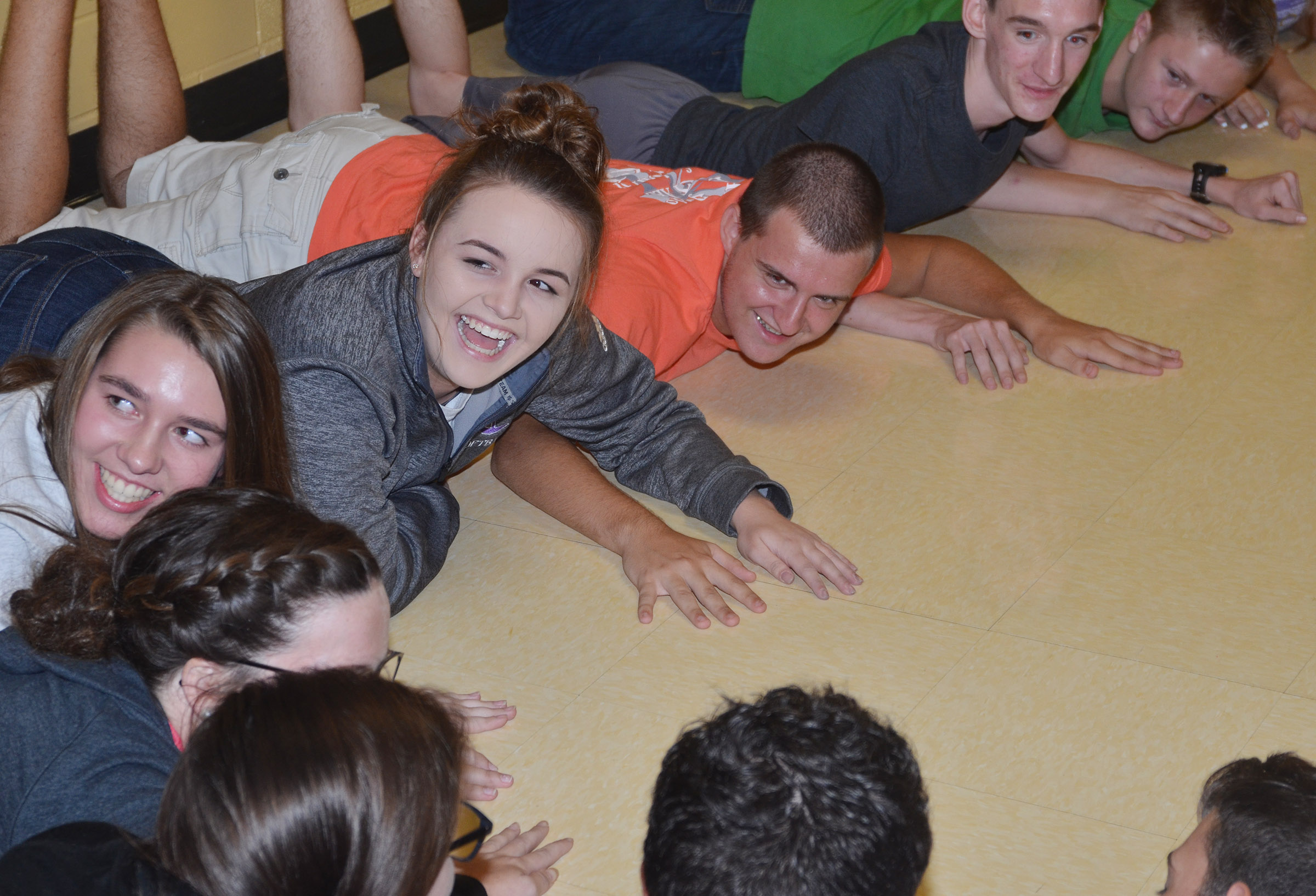 CHS freshmen Abi Wiedewitsch, at left, and Kenzi Forbis and senior Austin Fitzgerald play an ice-breaker game with their fellow FCA members.