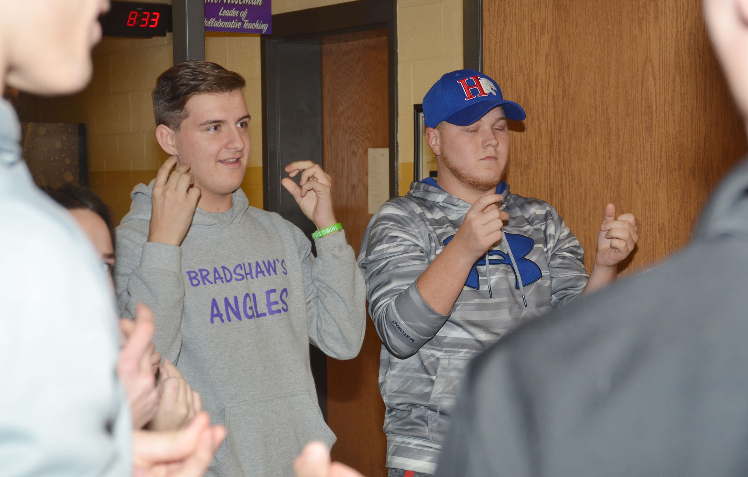 CHS FCA members Austin Fitzgerald, at left, a junior, and senior Noah Wagers play a game at a recent meeting.