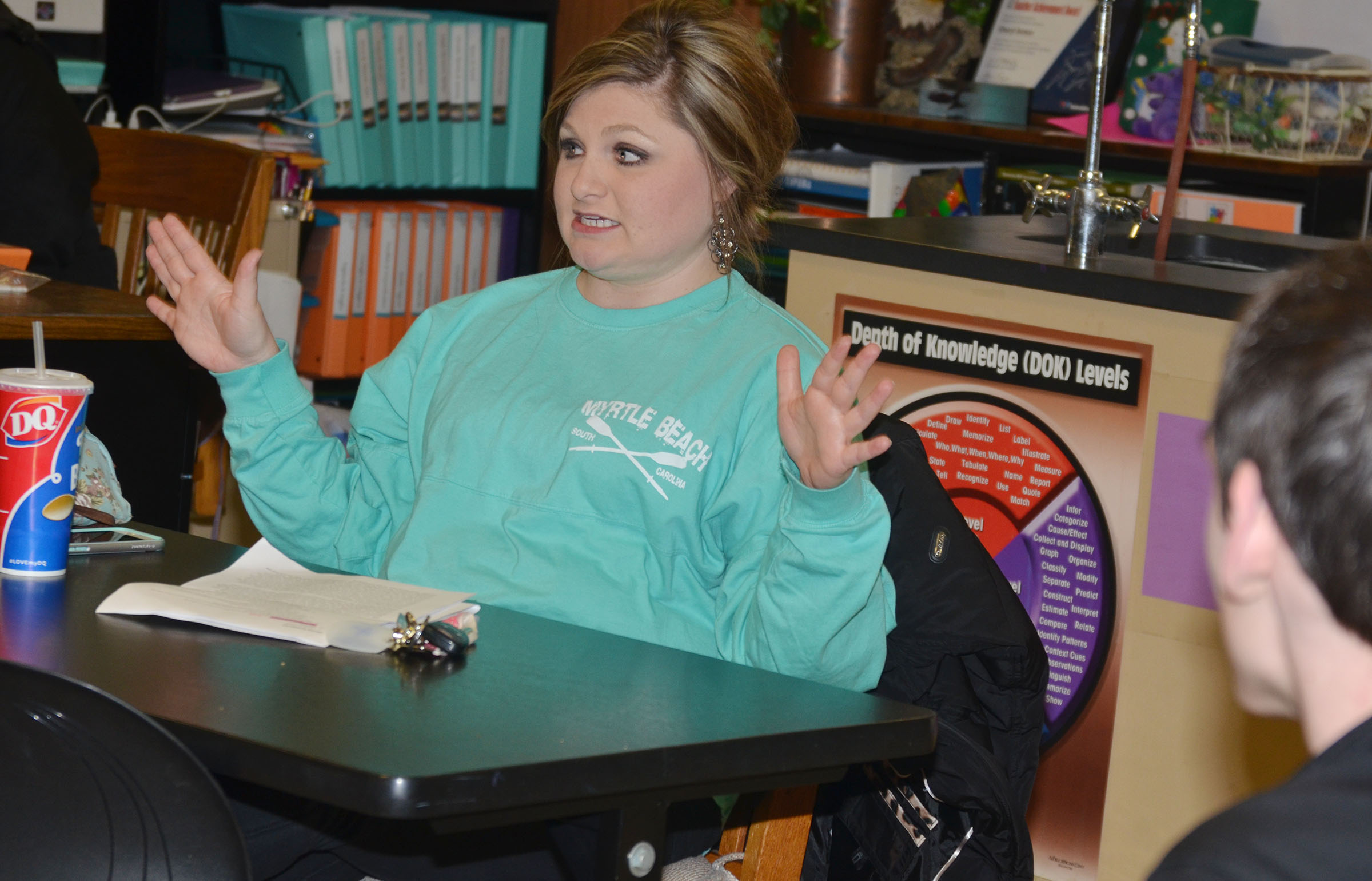 CHS science teacher Lauren Bennett tells her testimony at a recent FCA meeting.