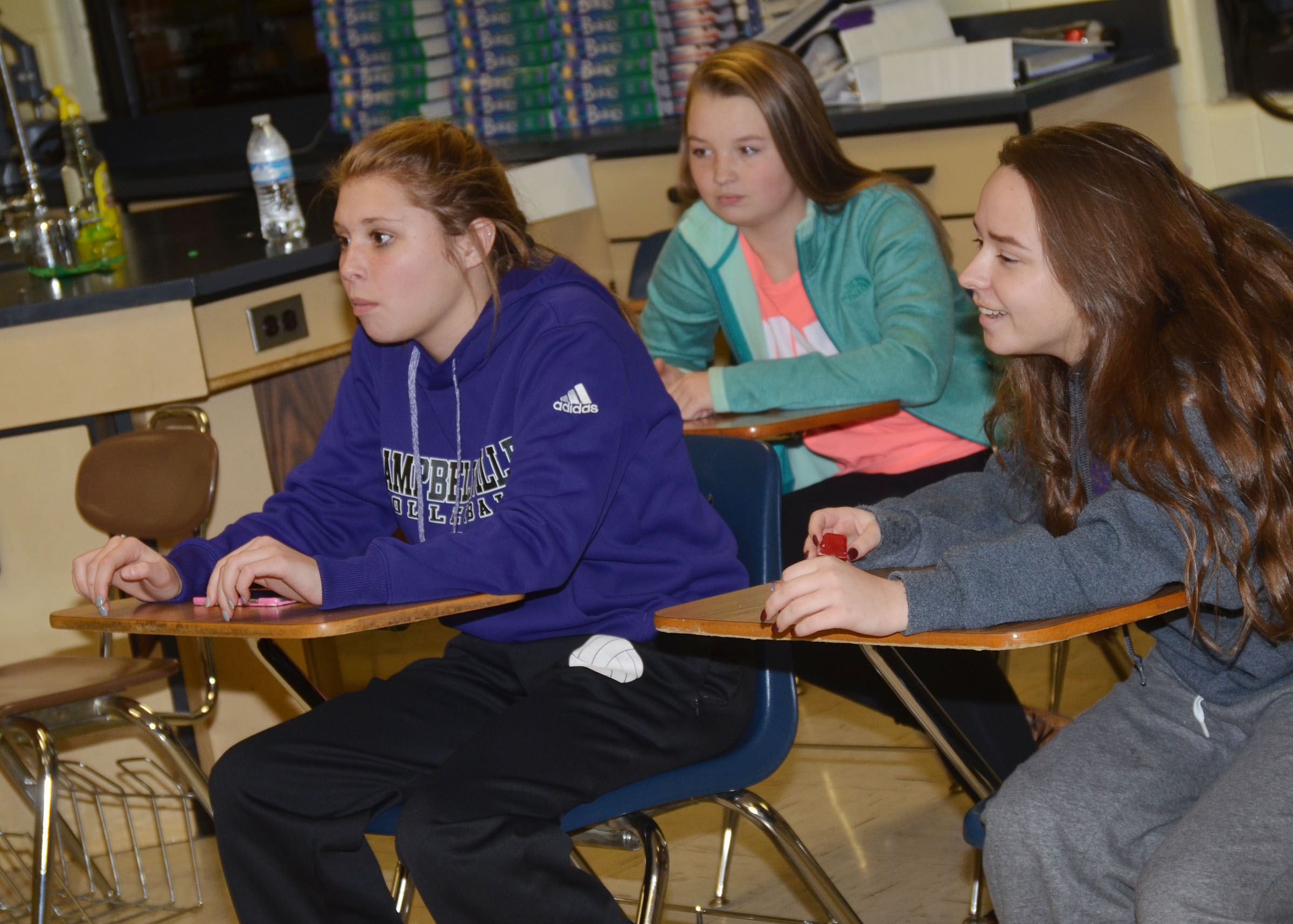 CHS FCA members meet for a small group devotional. From left are sophomores Chloe Gupton, Kaleigh Hunt and Christa Riggs.