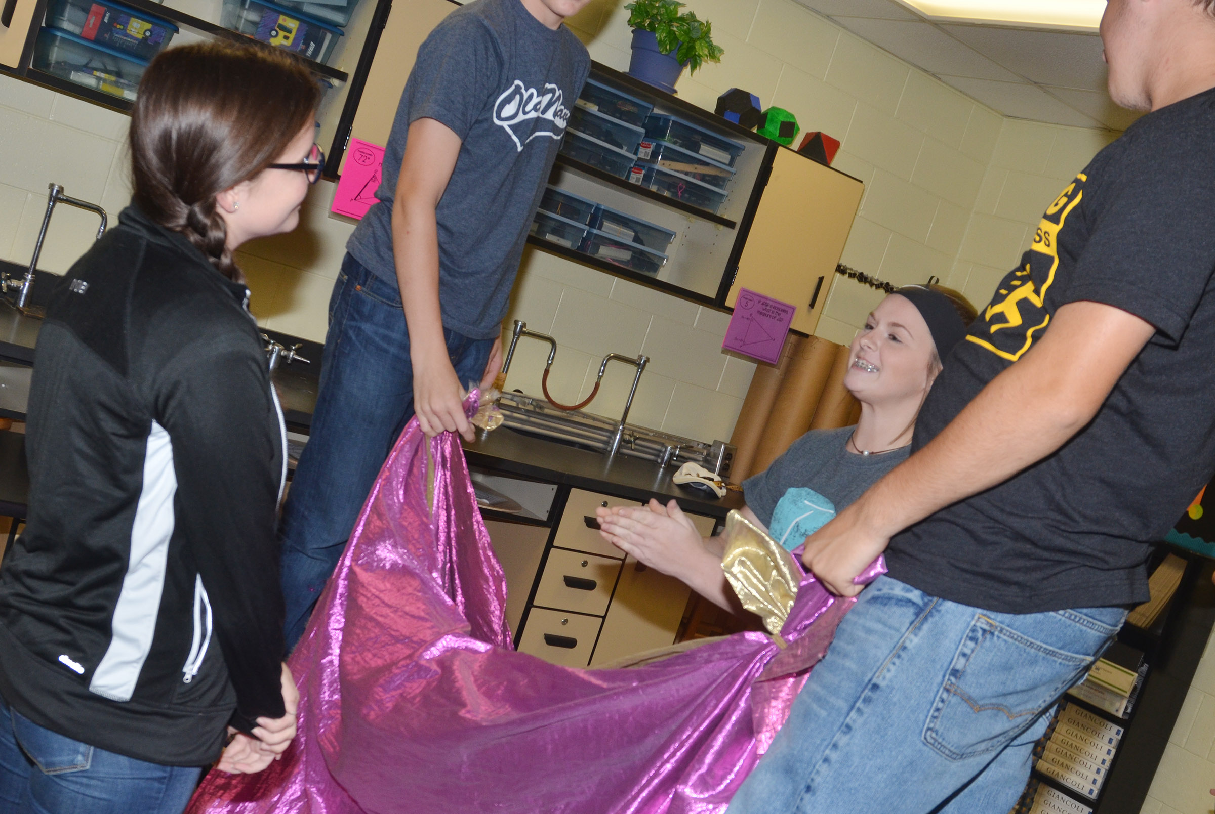 CHS sophomore Sydney Wilson, at left, plays the behind the curtain game with freshman Taylor Knight.
