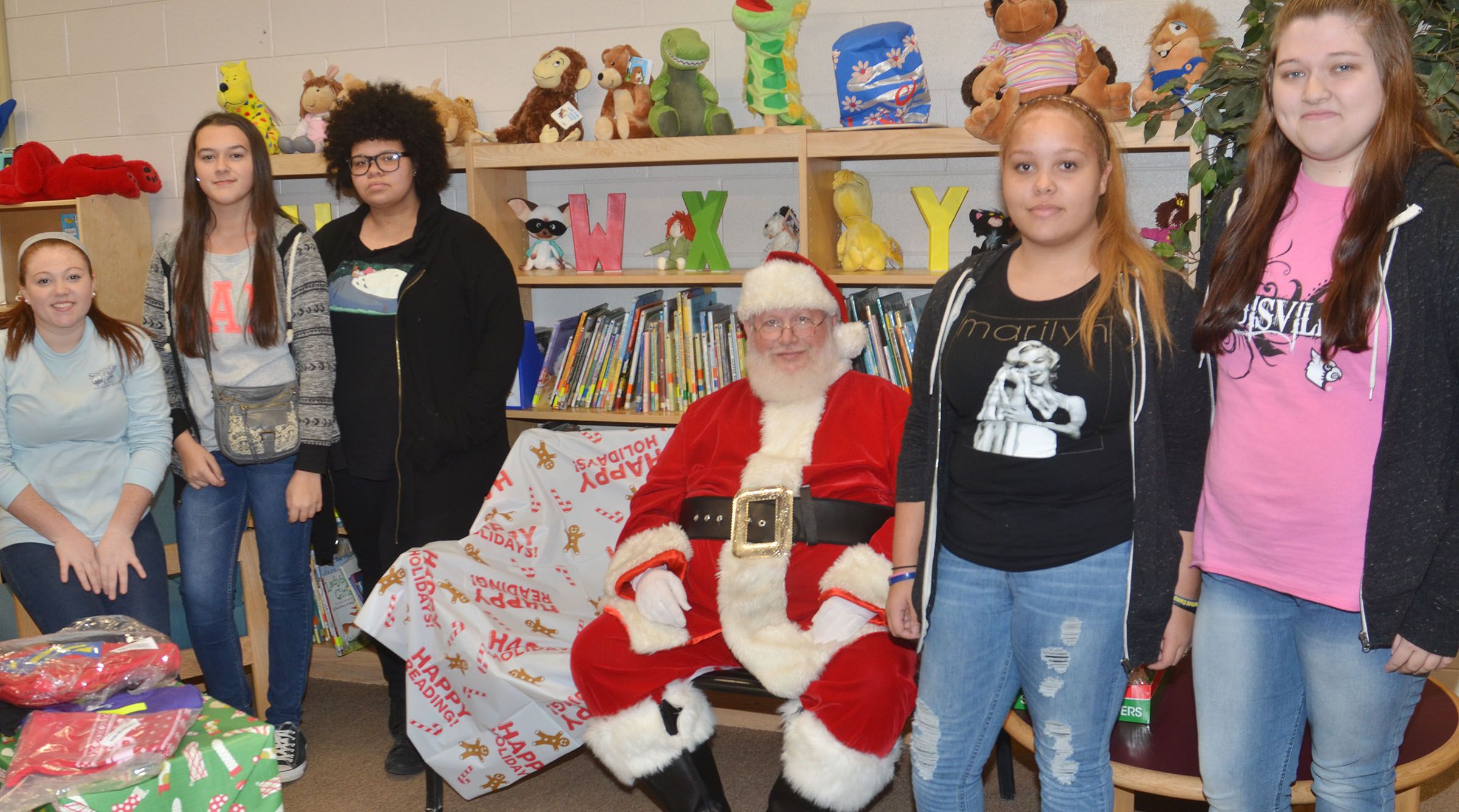 CHS FCCLA members, from left, sophomore Bethany Harris, junior Makala Antle, sophomore Jaylah Tucker and juniors Shailyn Fields and Lauren Riddle pose for a photo with Santa at a Christmas party for Campbellsville Elementary School students.