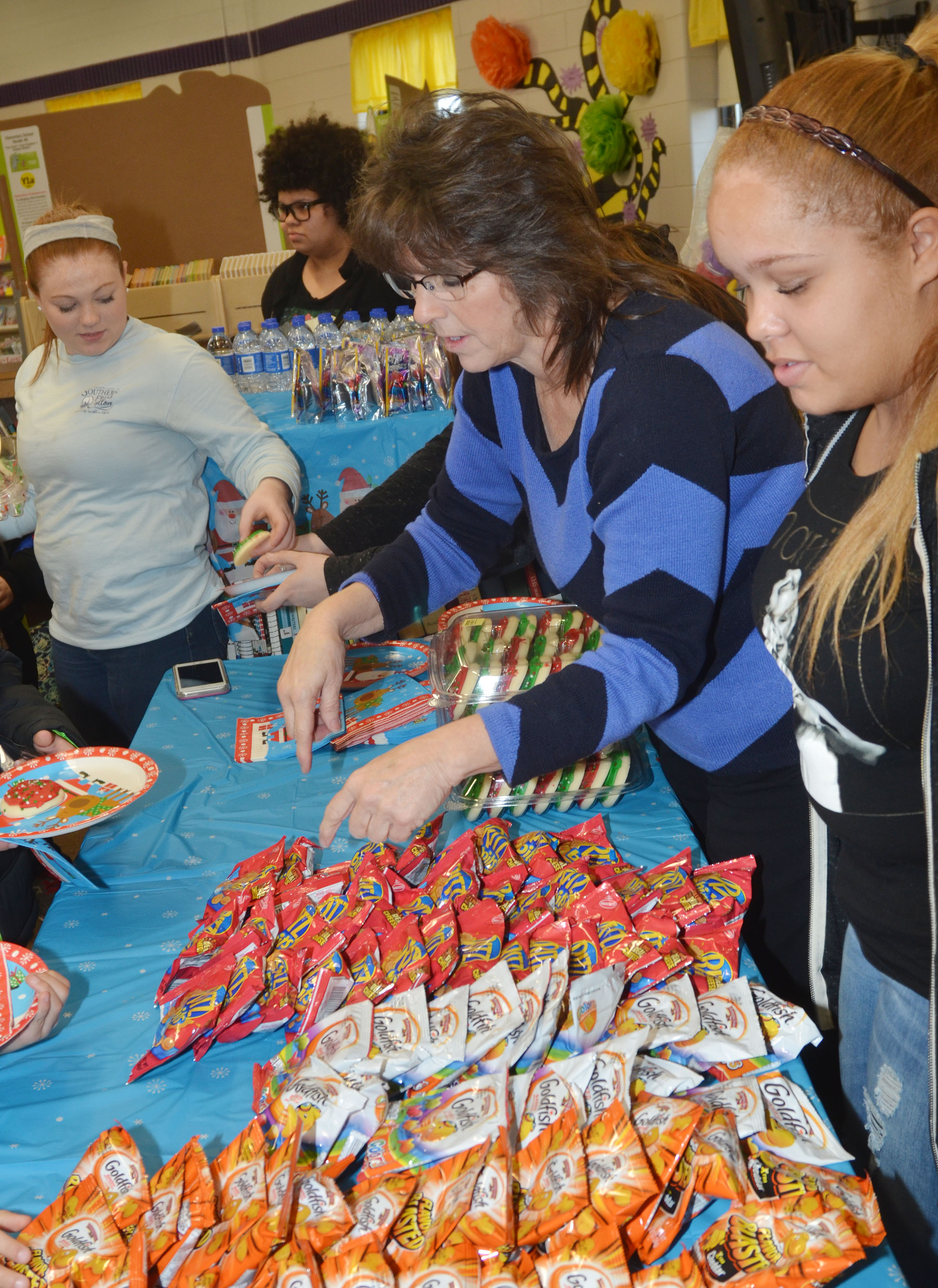CHS FCCLA members, from left, sophomores Bethany Harris and Jaylah Tucker, sponsor Deanna Campbell and member Shailyn Fields, a junior, serve snacks at a Christmas party for Campbellsville Elementary School students.