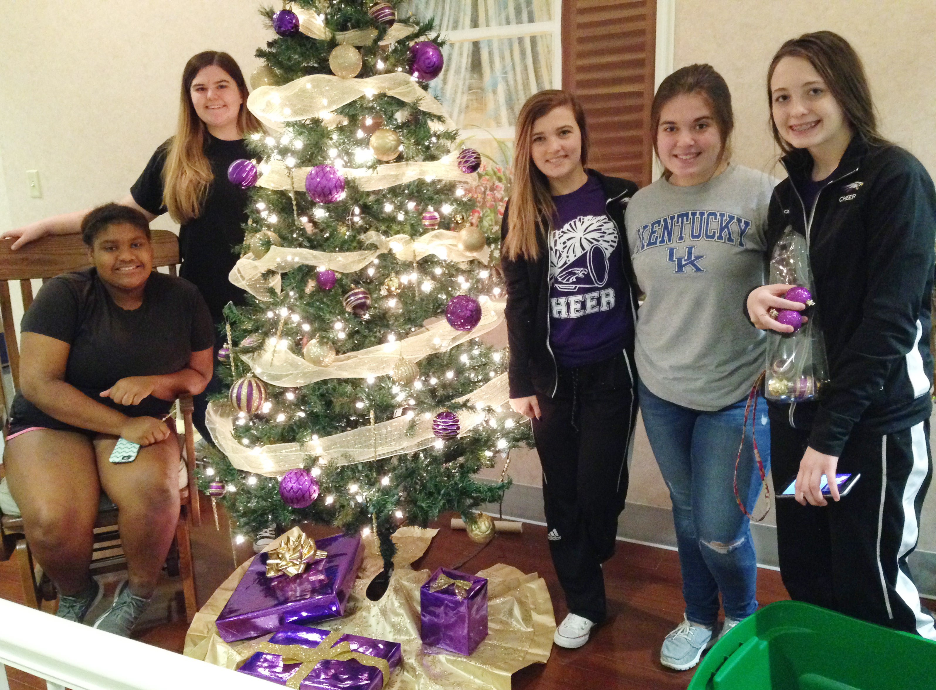 CHS FCCLA students, from left, sophomore Jakyia Mitchell, senior Vivian Brown, freshmen Carly Adams and Chloe Garrett and junior Caleigh Bright decorate the FCCLA club's Christmas tree, which is on display at the Grandview.