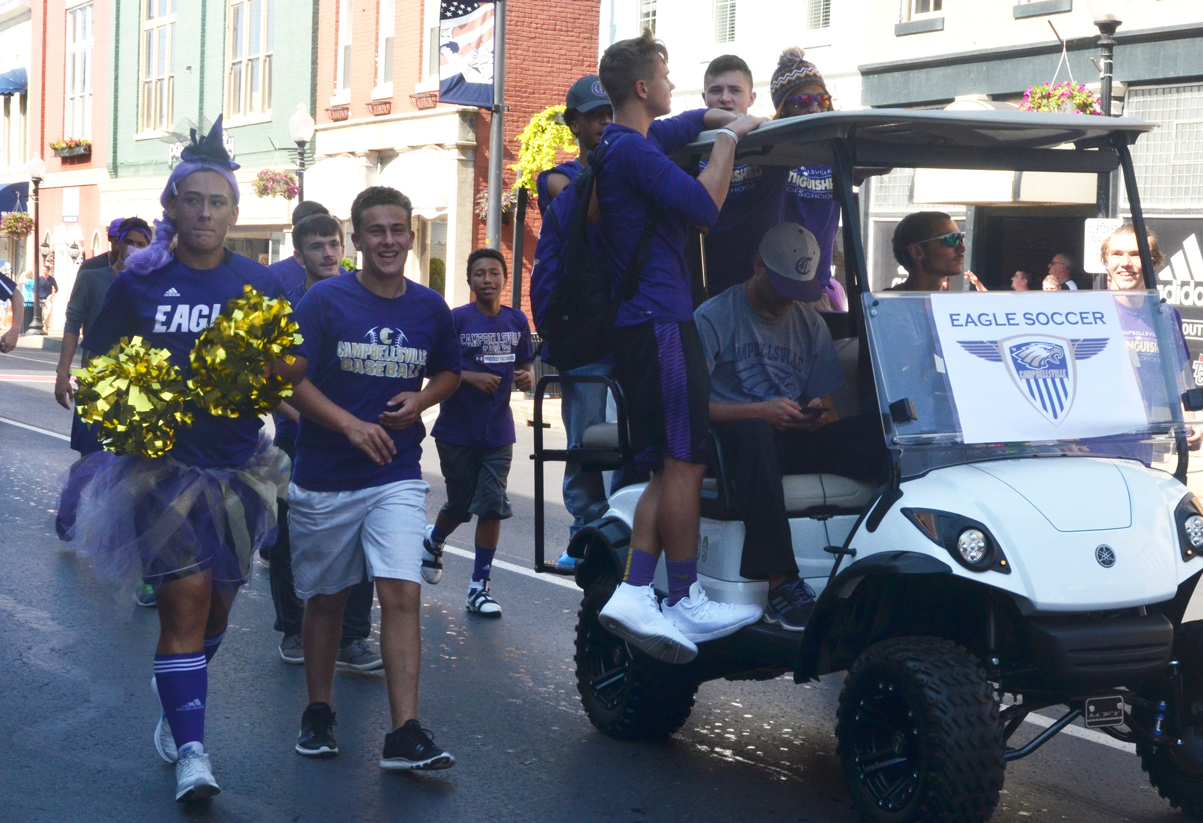 CHS soccer players ride in the parade.