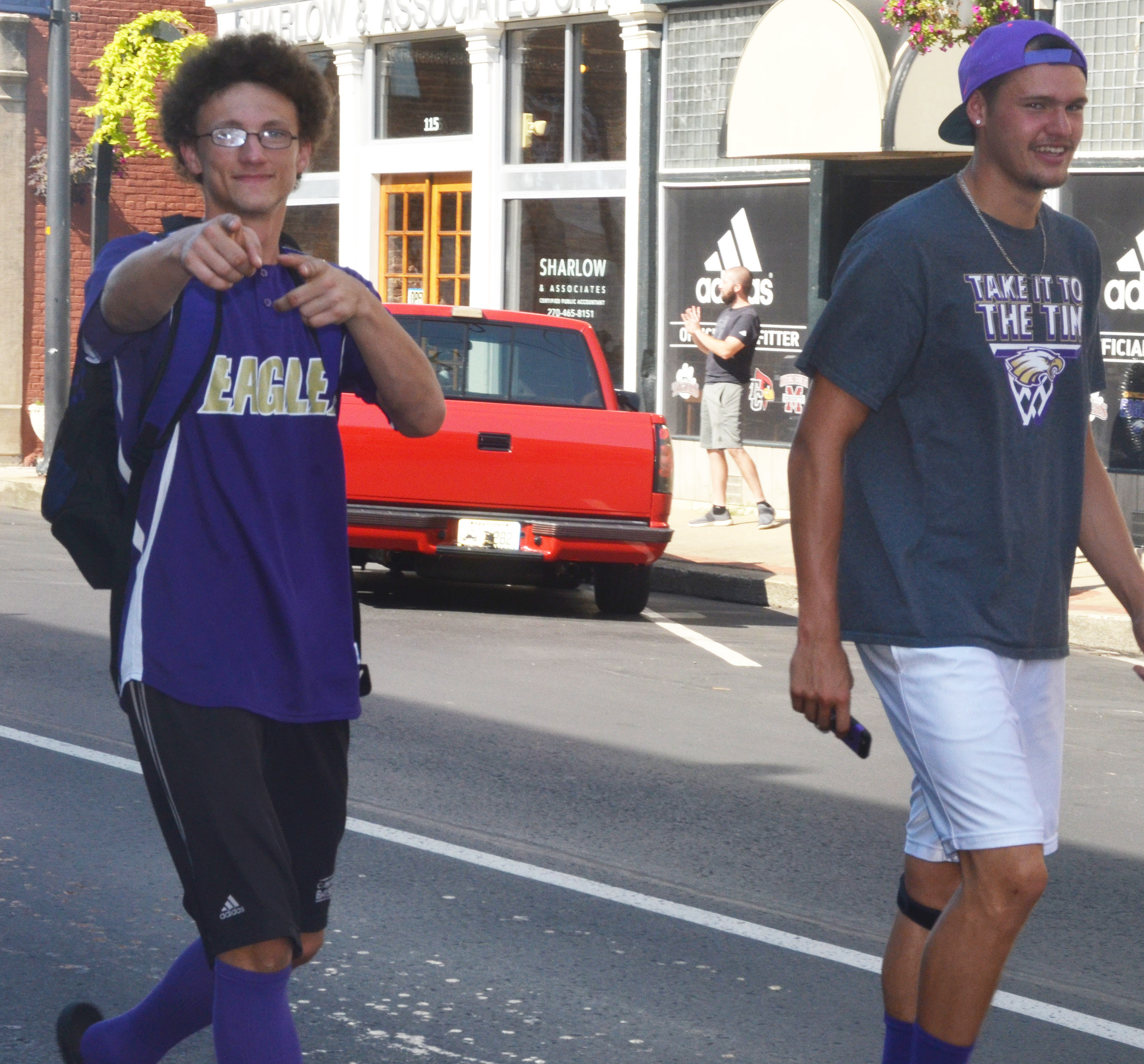 CHS soccer players Brennon Wheeler, a sophomore, at left, and senior Logan Cole walk in the parade.
