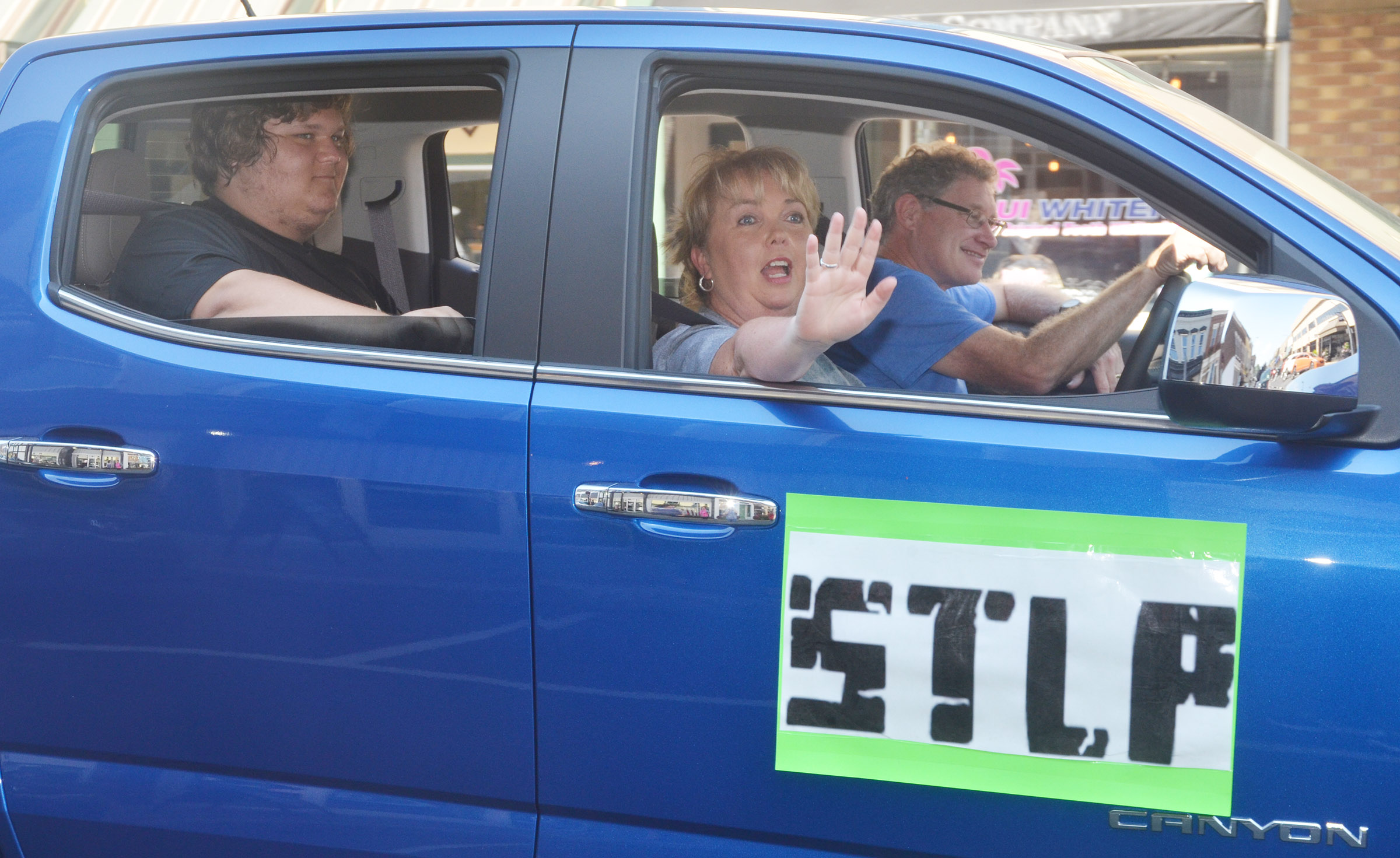 CHS junior Randy Harris rides in the STLP car with sponsor Sonya Kessler.