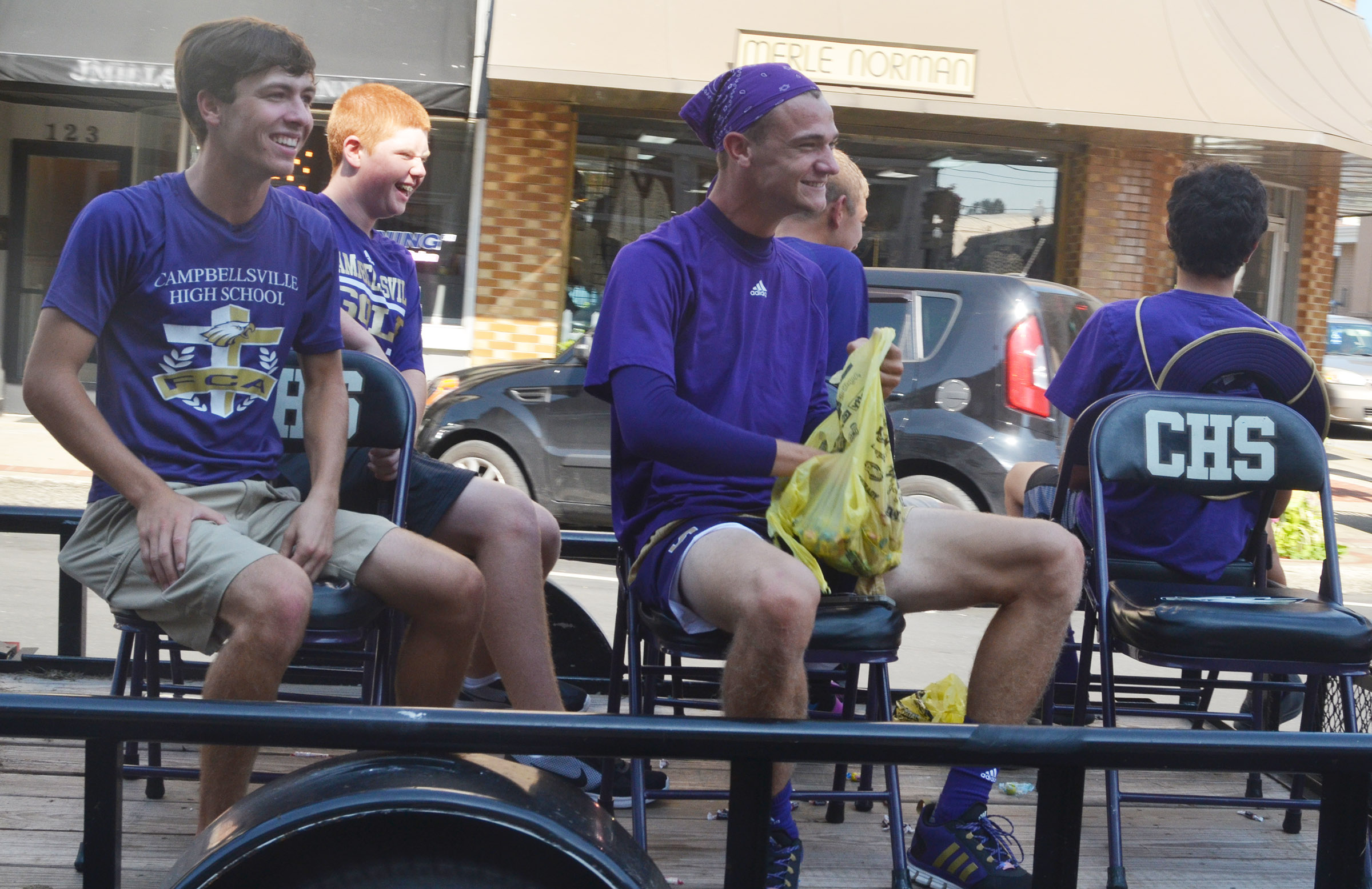 CHS boys' golf team members ride in the parade. From left are junior Layton Hord, freshman Colin Harris and senior Connor Wilson.