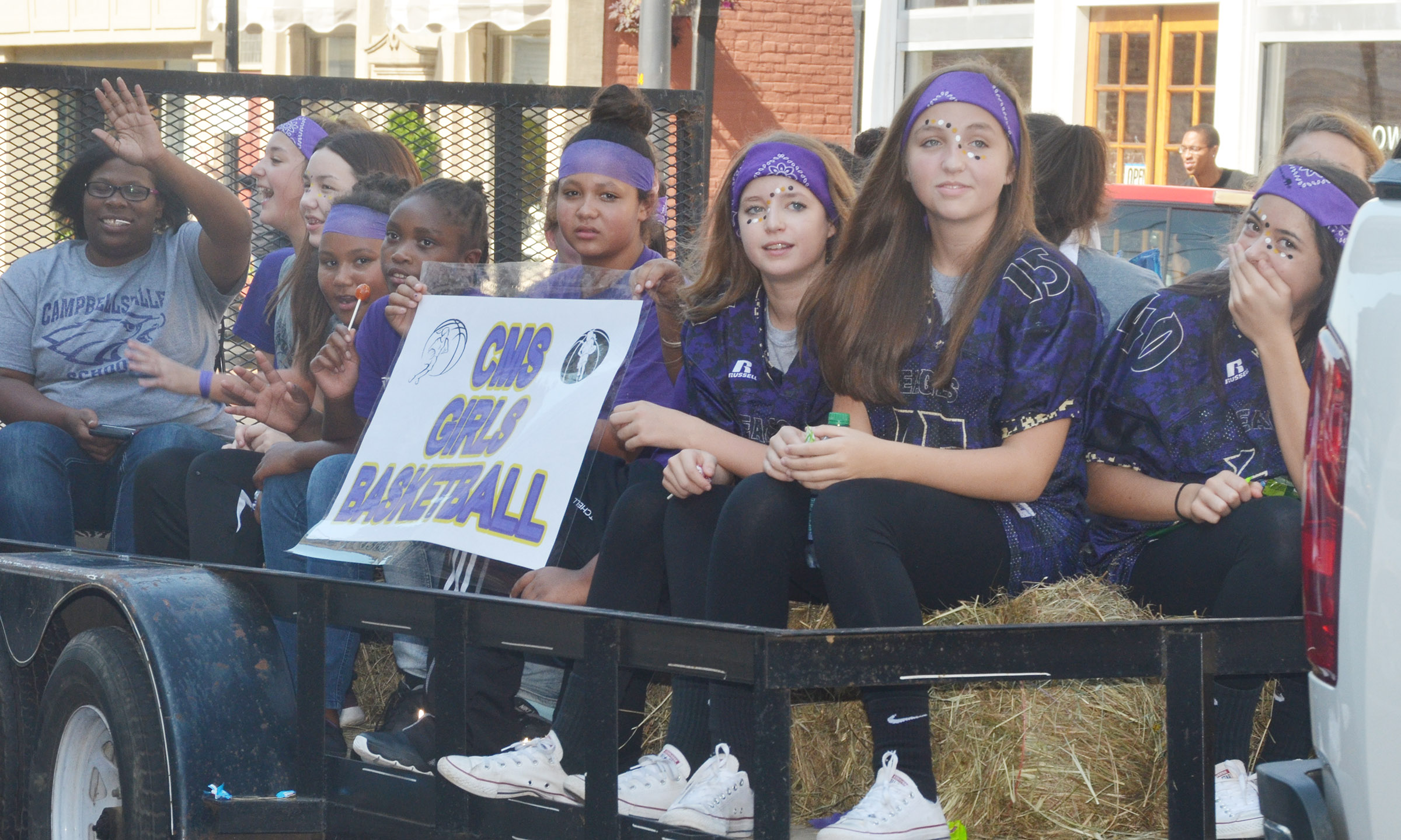 CMS girls' basketball players ride in the parade.