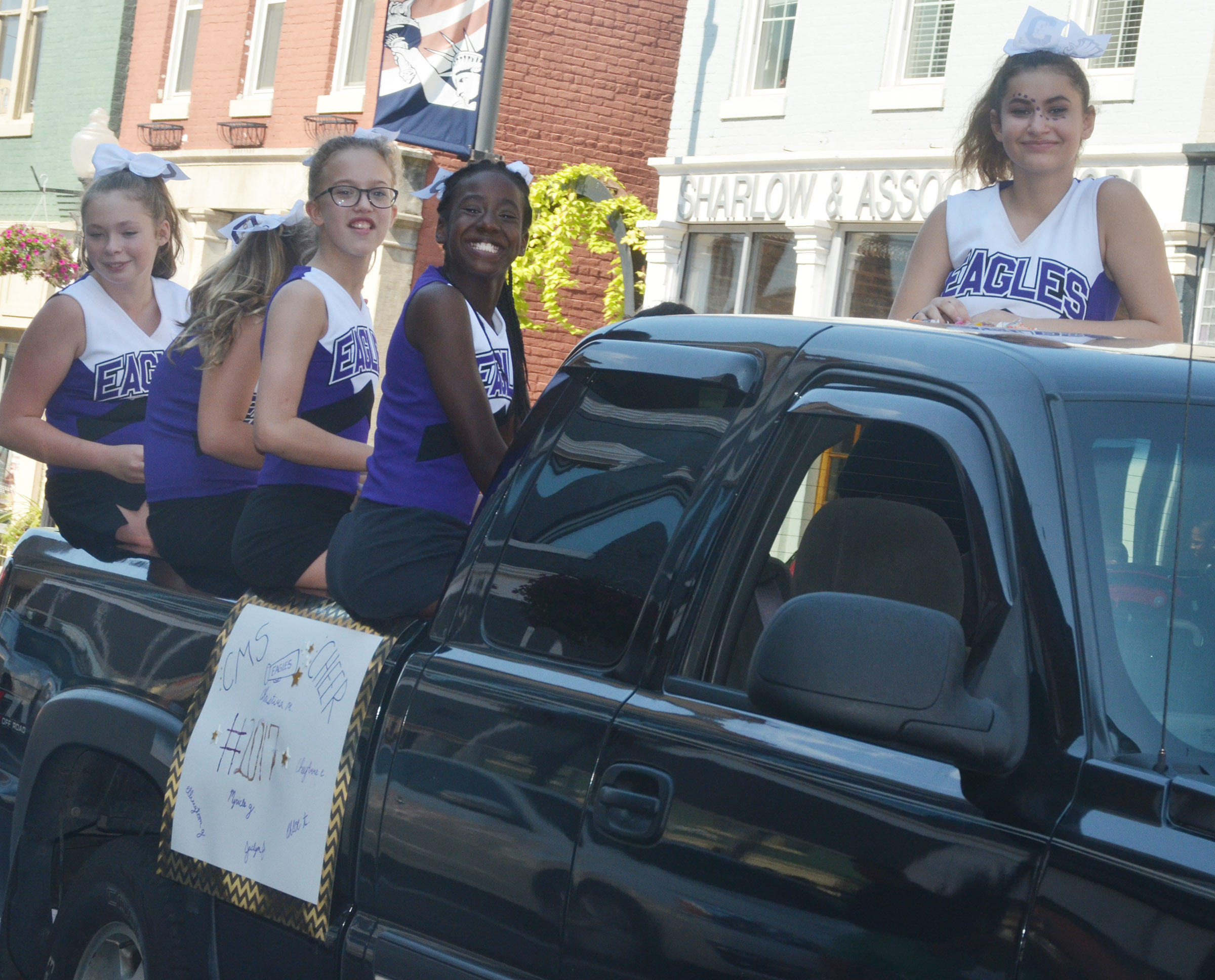 CMS cheerleaders ride in the parade.