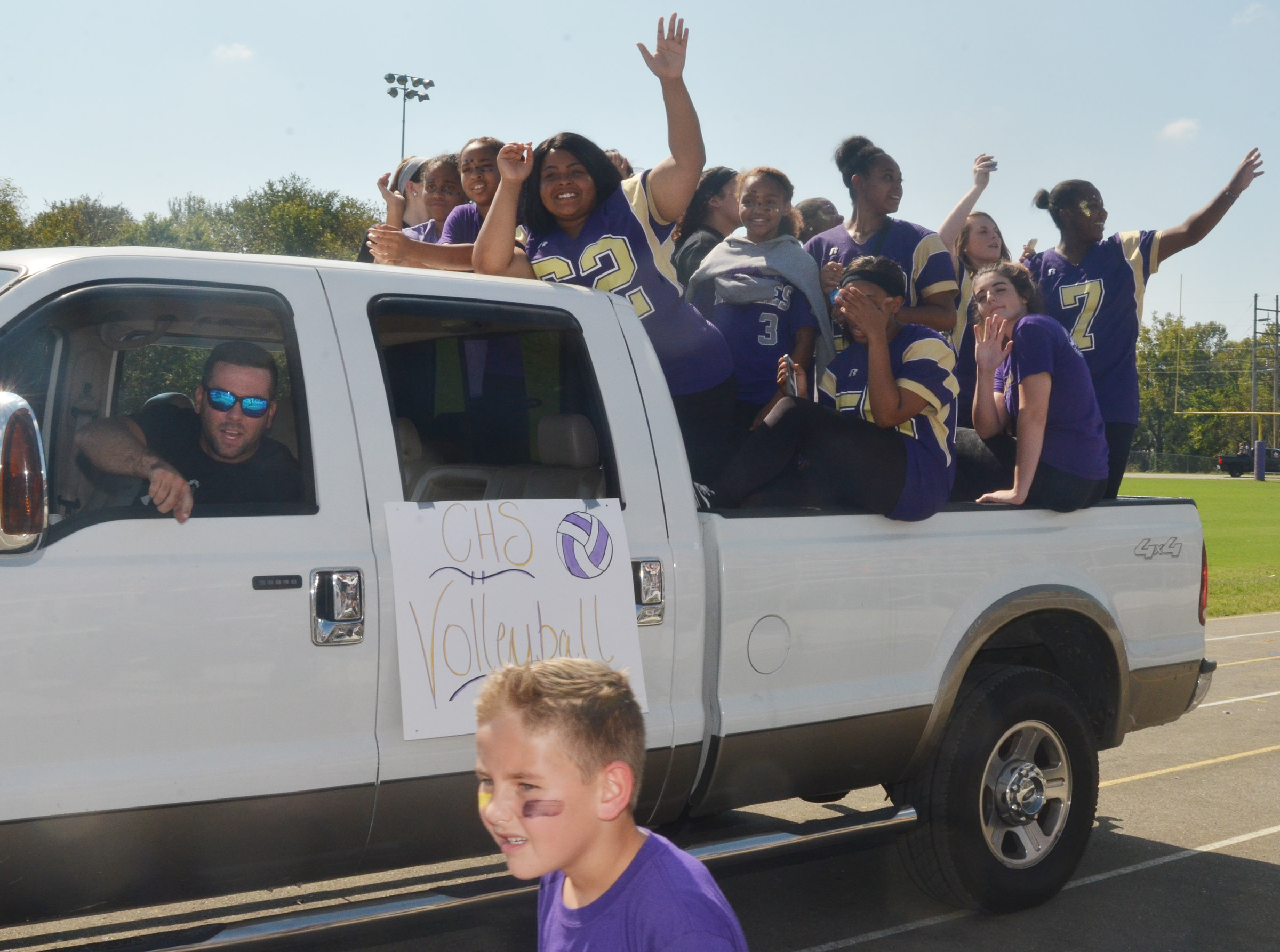 CHS volleyball players ride in the parade.
