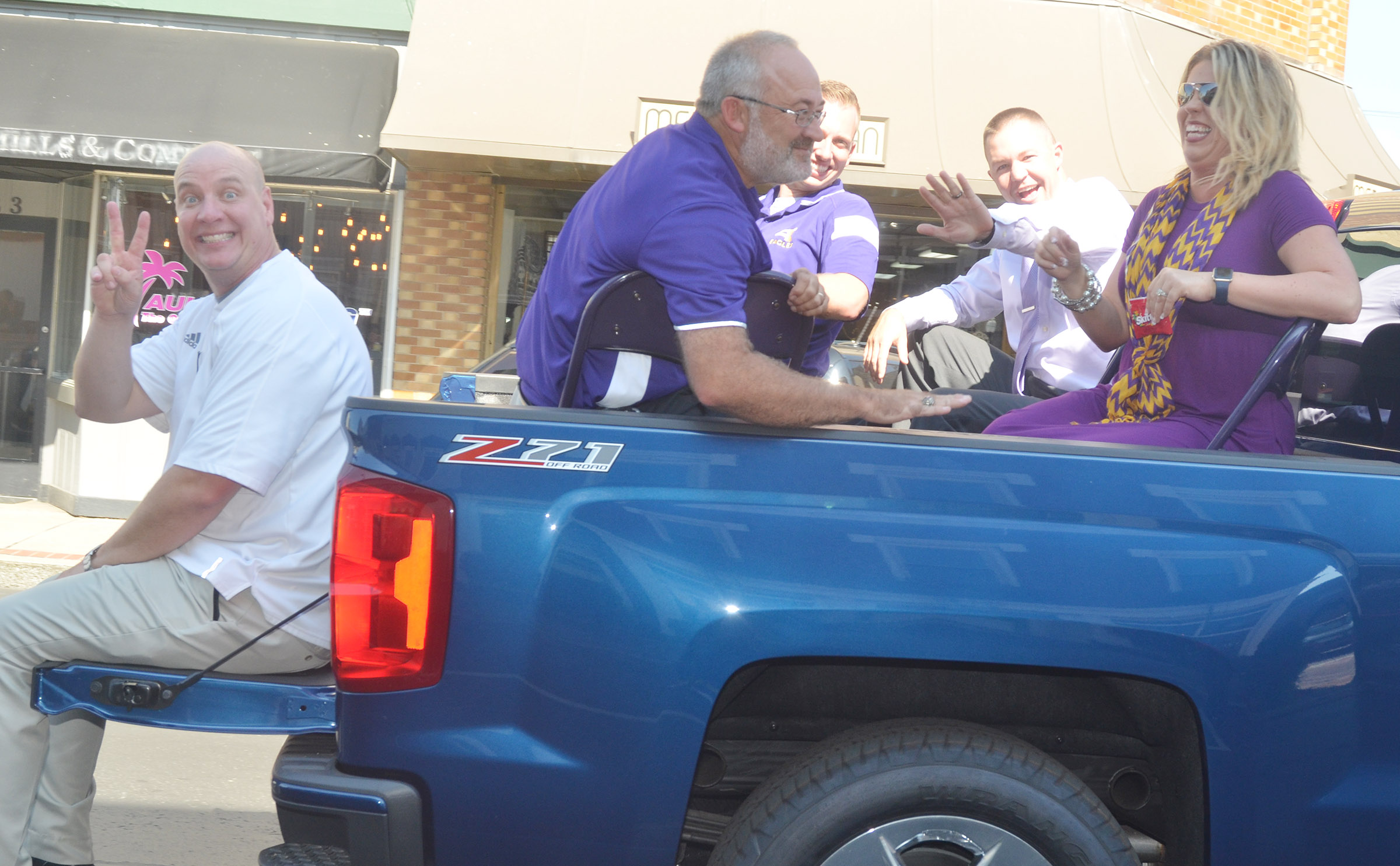CIS principals, from left, David Petett, Tim Bailey, Zach Lewis, Weston Jones and Elisha Rhodes ride in the parade.