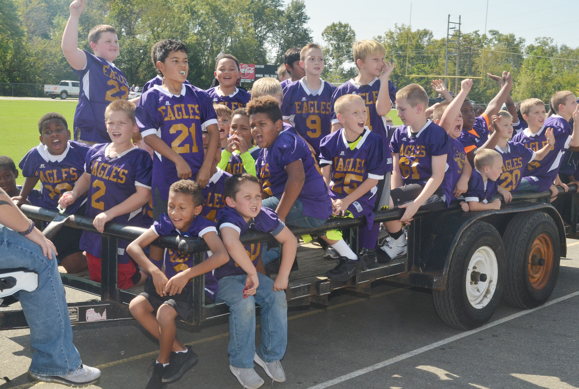 Campbellsville youth football players ride in the parade.