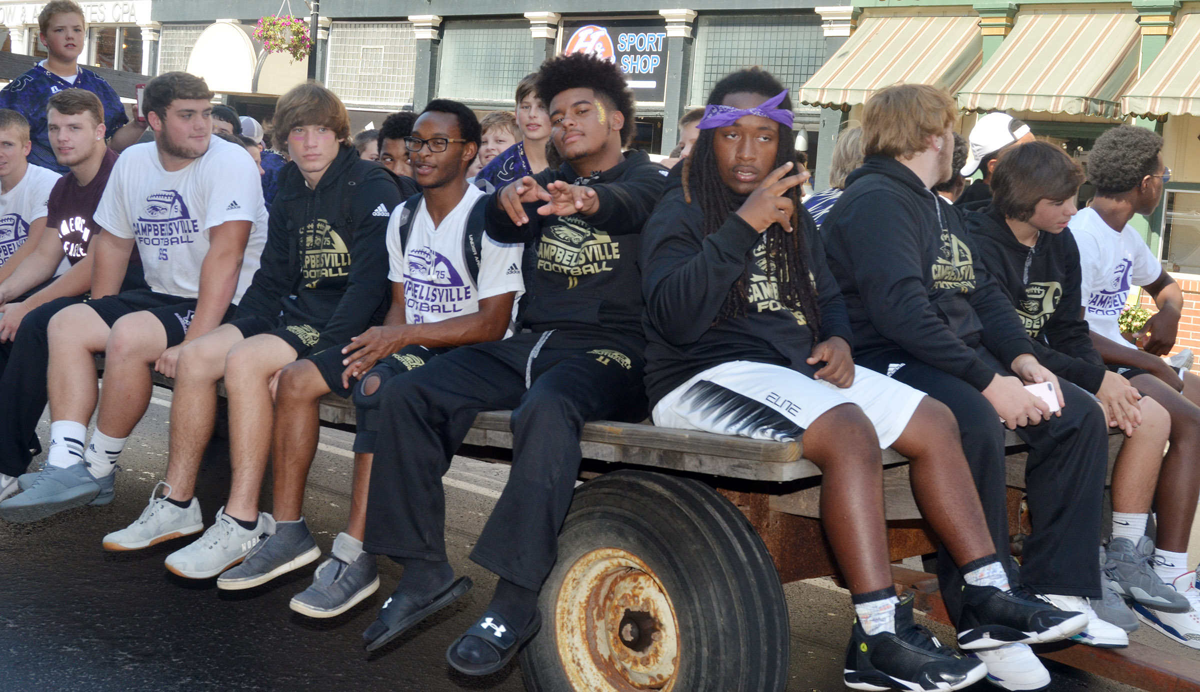 CHS football players ride in the parade.