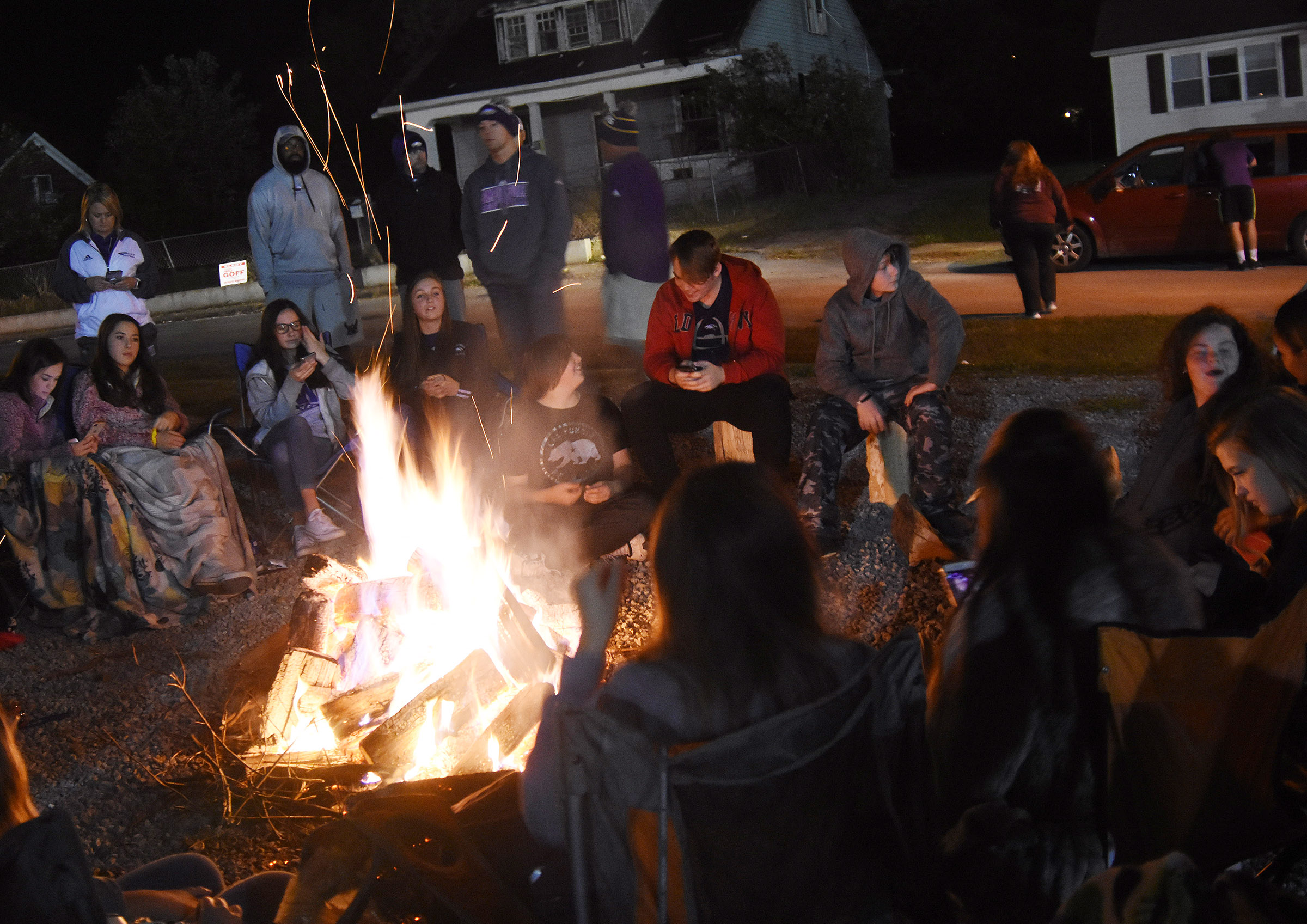 CHS students talk as they sit around the bonfire.