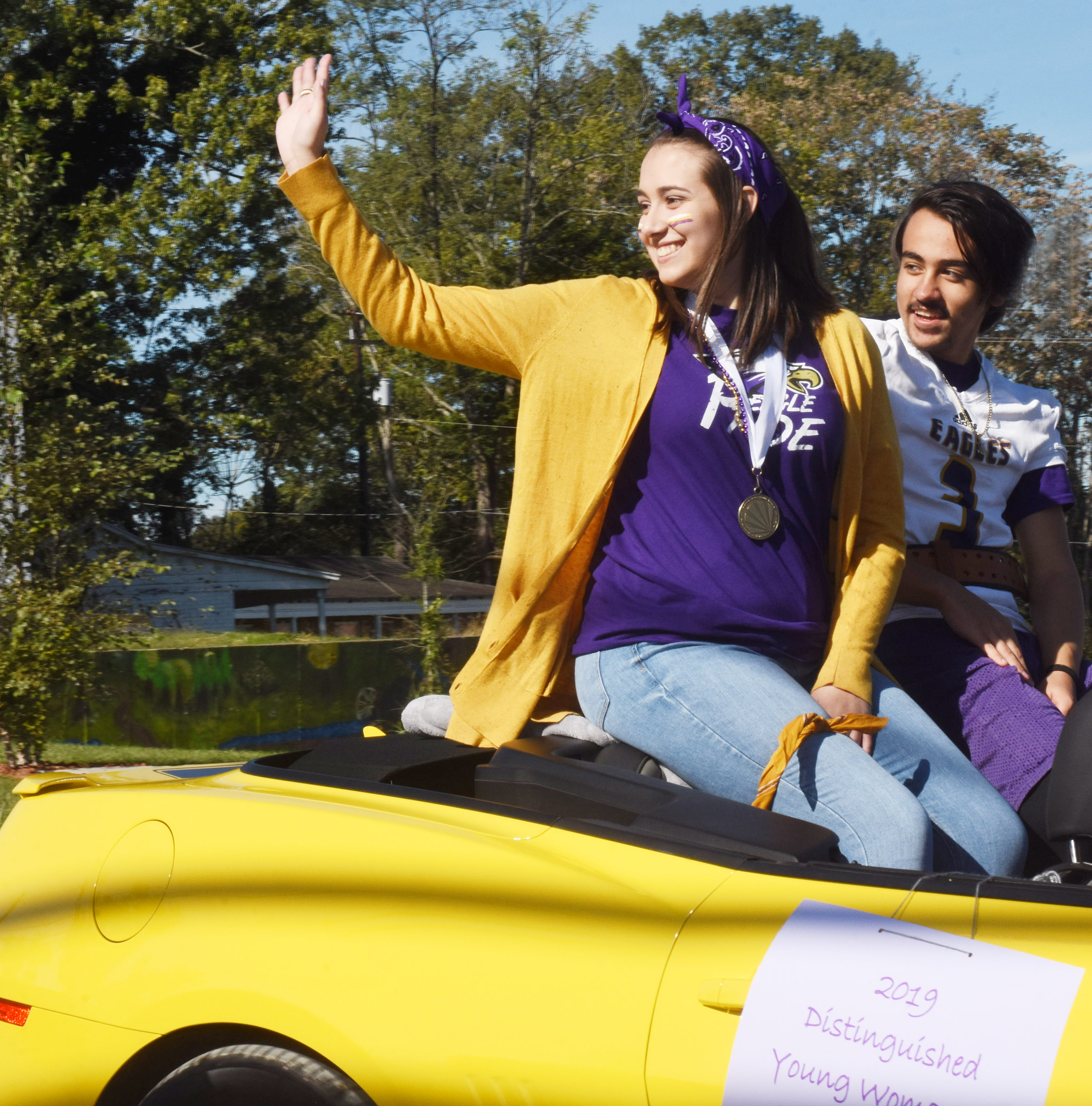 CHS homecoming candidates Elizabeth Sullivan and Glenn Lamer, representing the senior class, ride in the parade.