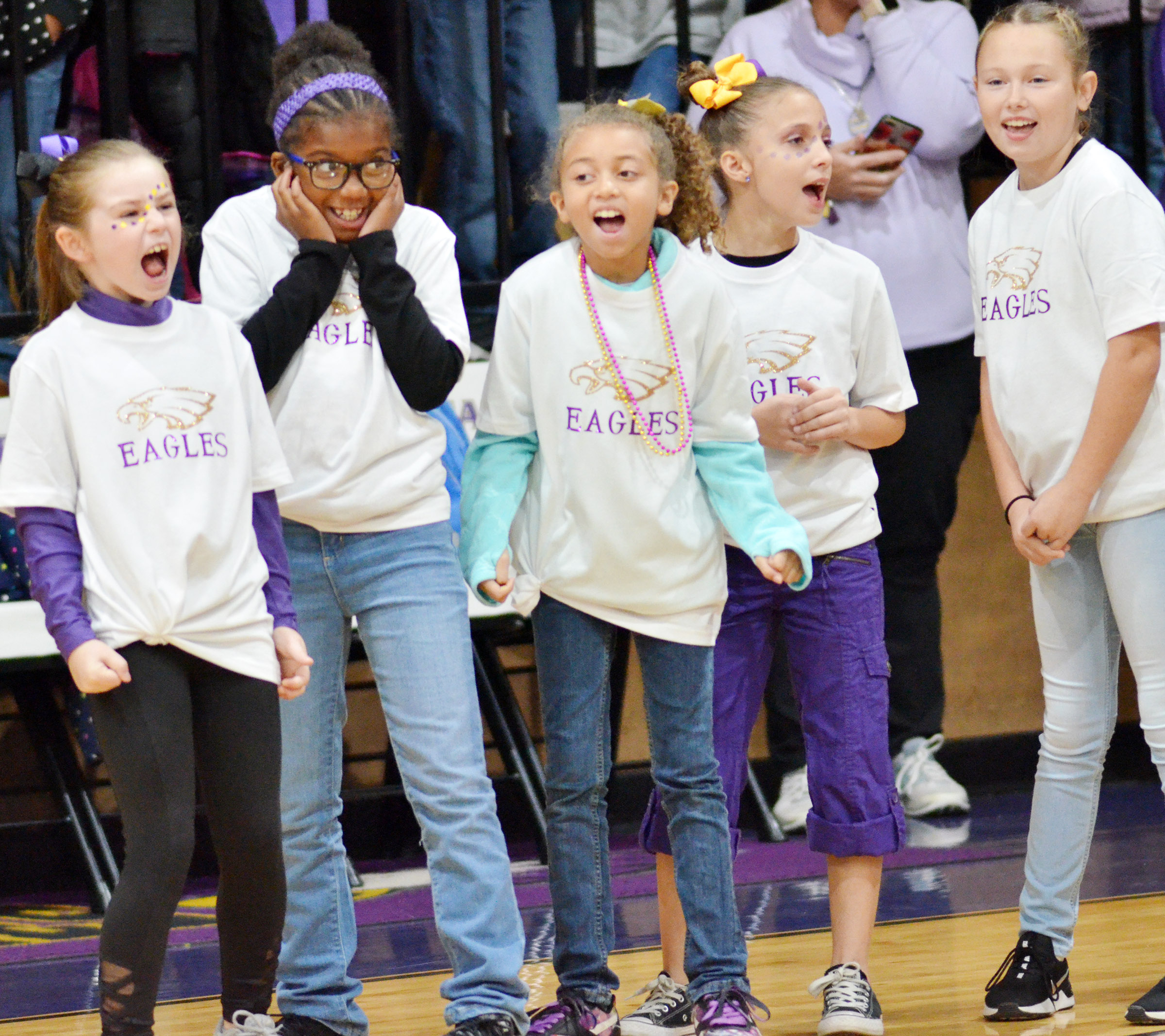 CES cheerleaders yell for the Eagles. From left are third-graders Lainey Price, Willow Griffin, Londyn Smith, Lillian Martin and River McFarland.